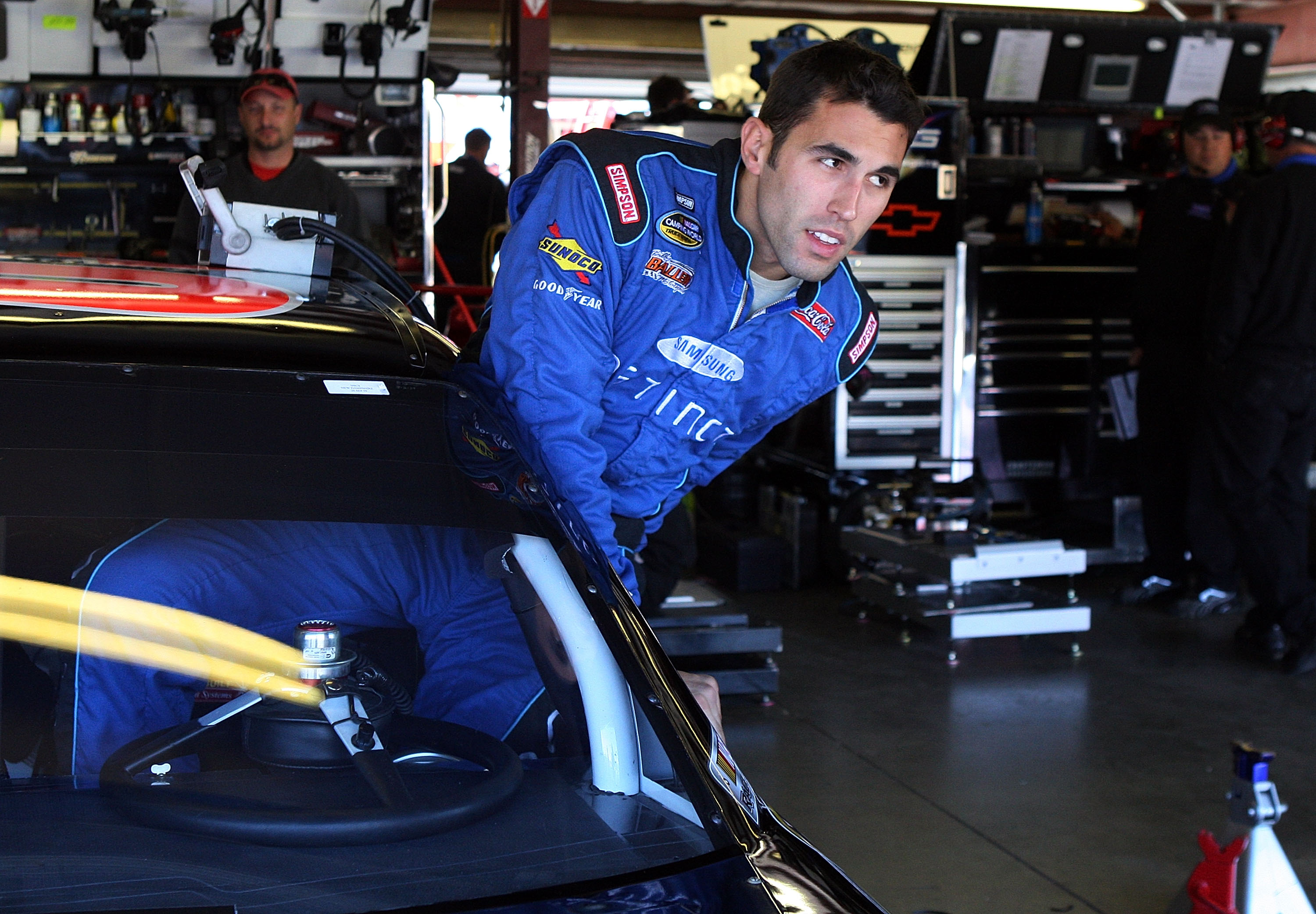 LOUDON, NH - SEPTEMBER 19:  Aric Amirola, driver of the #09 Miccosukee Indian Gaming & Resort Chevrolet, climbs into his car during practice for the NASCAR Sprint Cup Series Sylvania 300 at the New Hampshire Motor Speedway on September 19, 2009 in Loudon,
