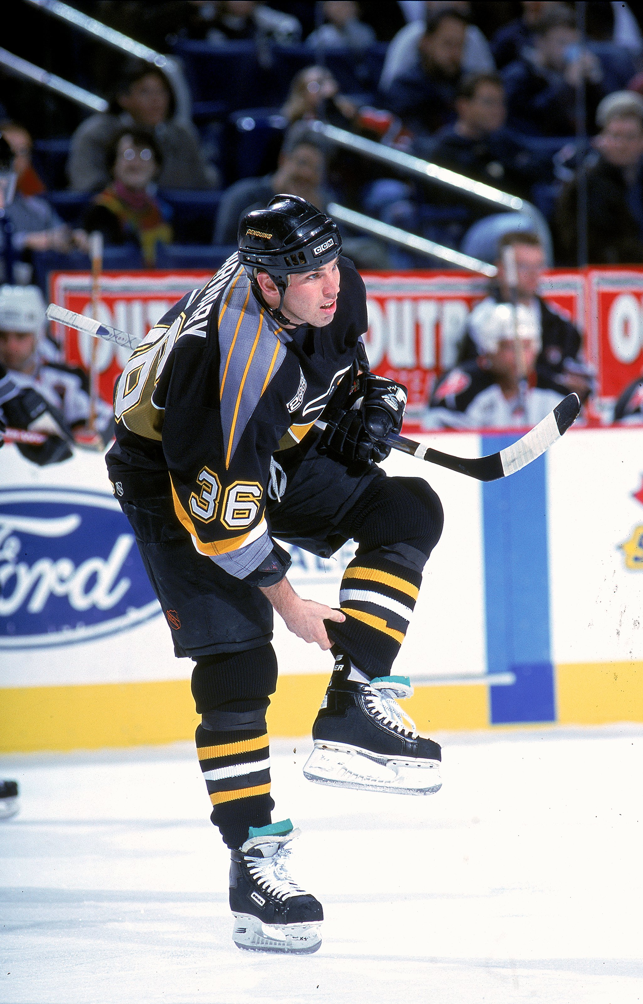 81e98ef1c 30 Nov 1999  Matthew Barnaby  36 of the Pittsburgh Penguins adjusts his  pant legs