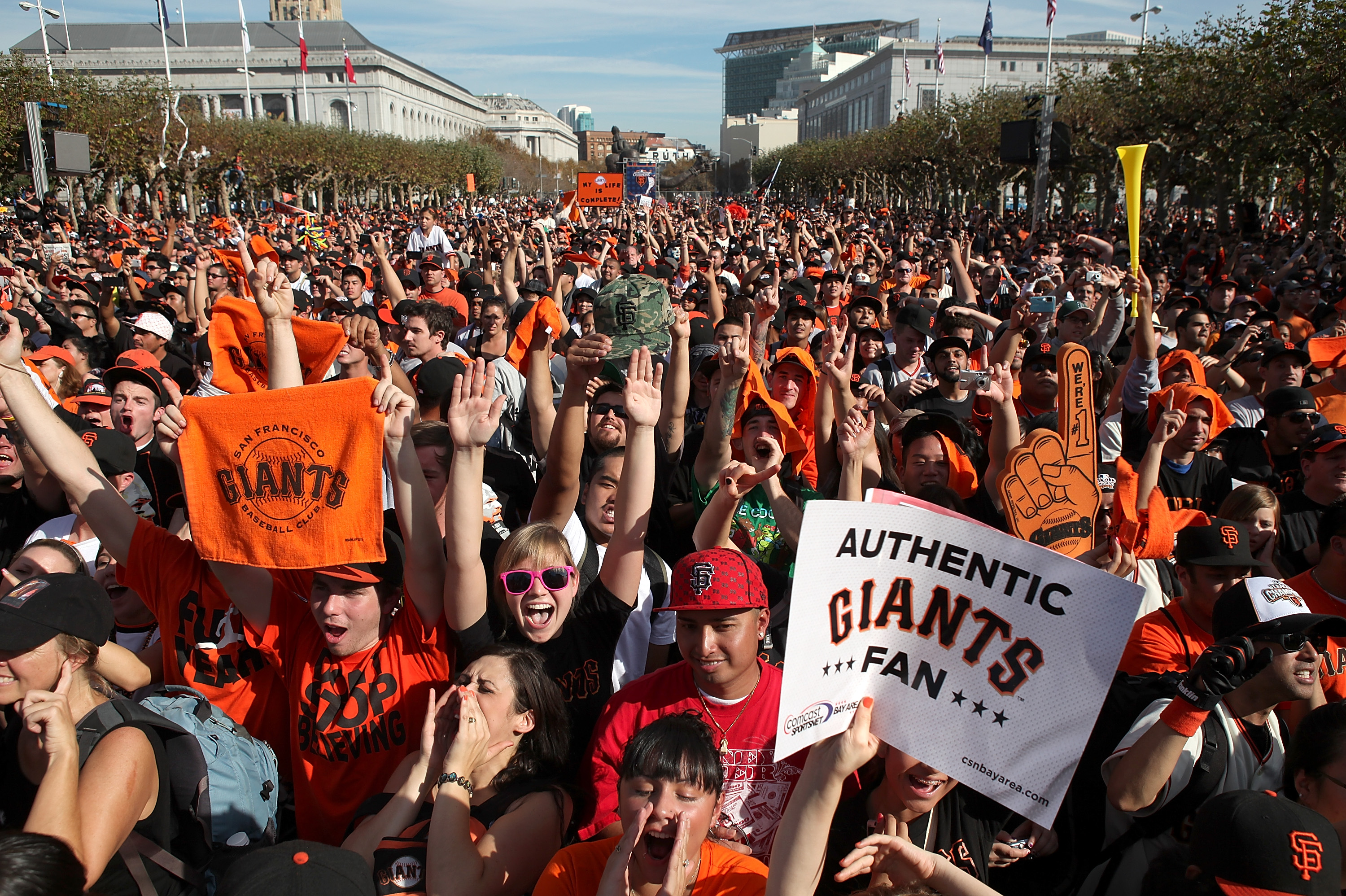 SAN FRANCISCO - NOVEMBER 03:  San Francisco Giants fans pack into the Civic Center Plaza during the Giants' victory parade on November 3, 2010 in San Francisco, California. Thousands of Giants fans lined the streets of San Francisco to watch the San Franc