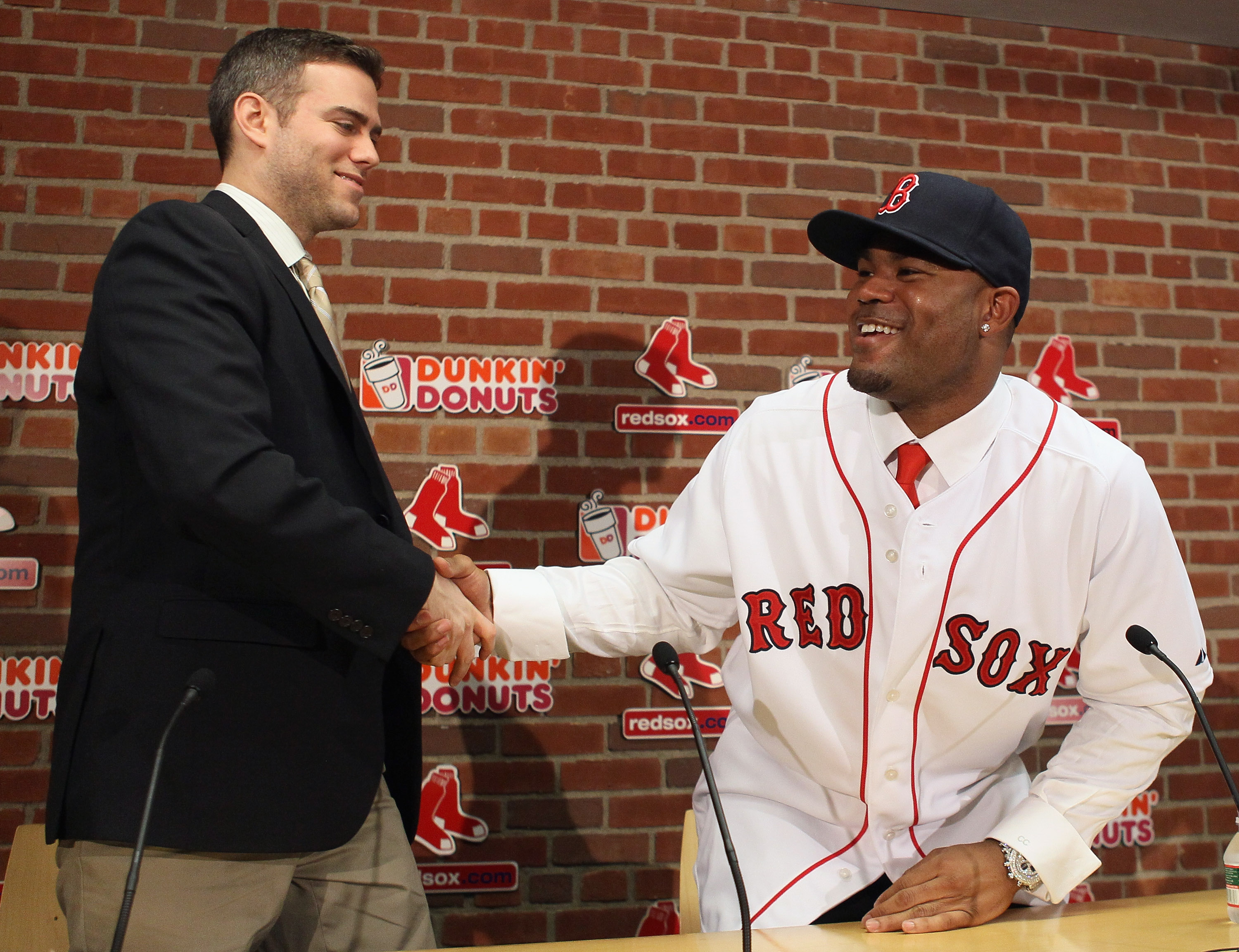 Red Sox GM Theo Epstein (left) welcomes Boston's newest weapon, Carl Crawford.