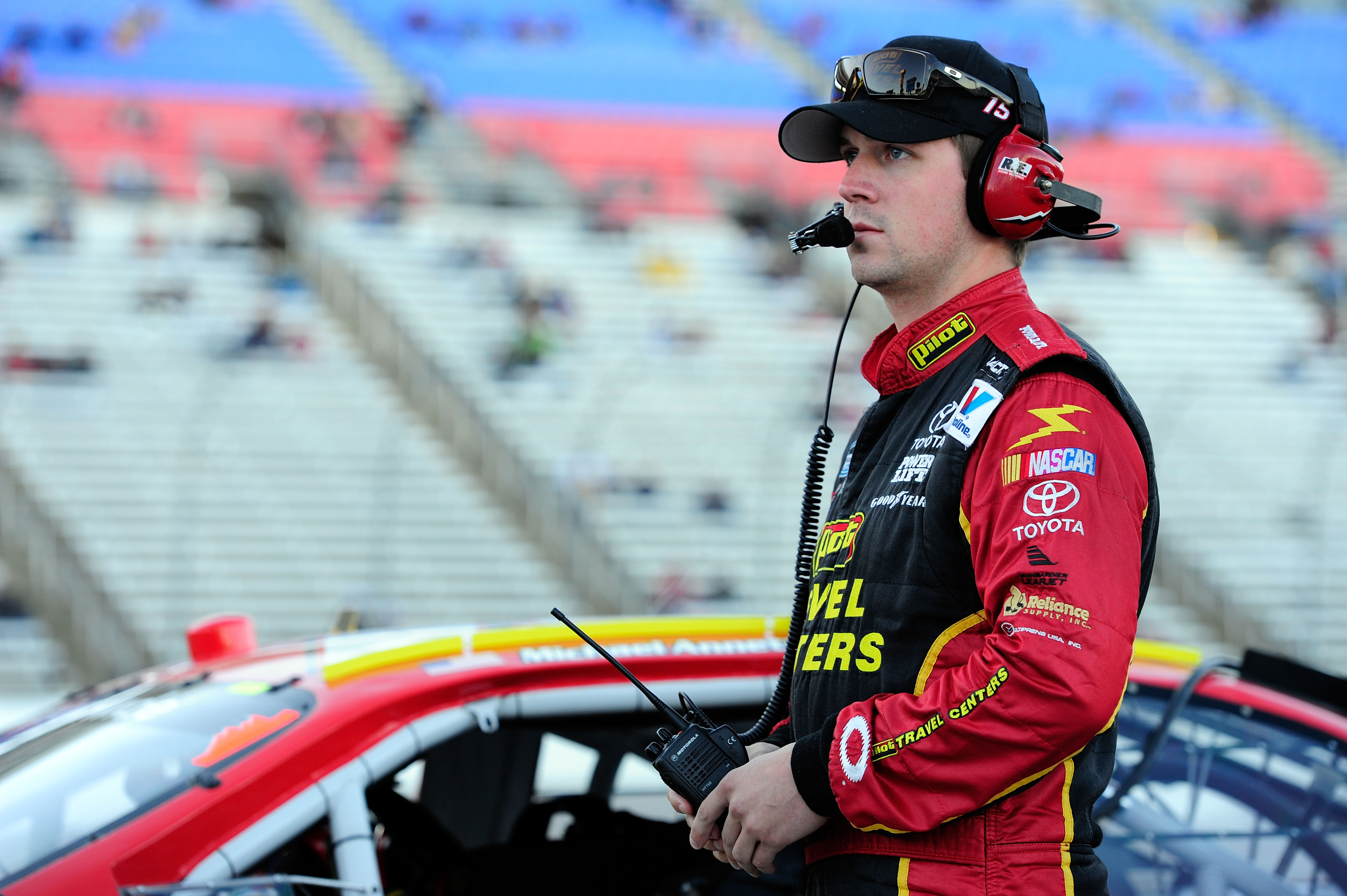 FORT WORTH, TX - NOVEMBER 05:  Michael Annett, driver of the #15 Pilot Flying J Coffee Toyota, stands on the grid during qualifying for the NASCAR Nationwide Series O'Reilly Auto Parts Challenge at Texas Motor Speedway on November 5, 2010 in Fort Worth, T