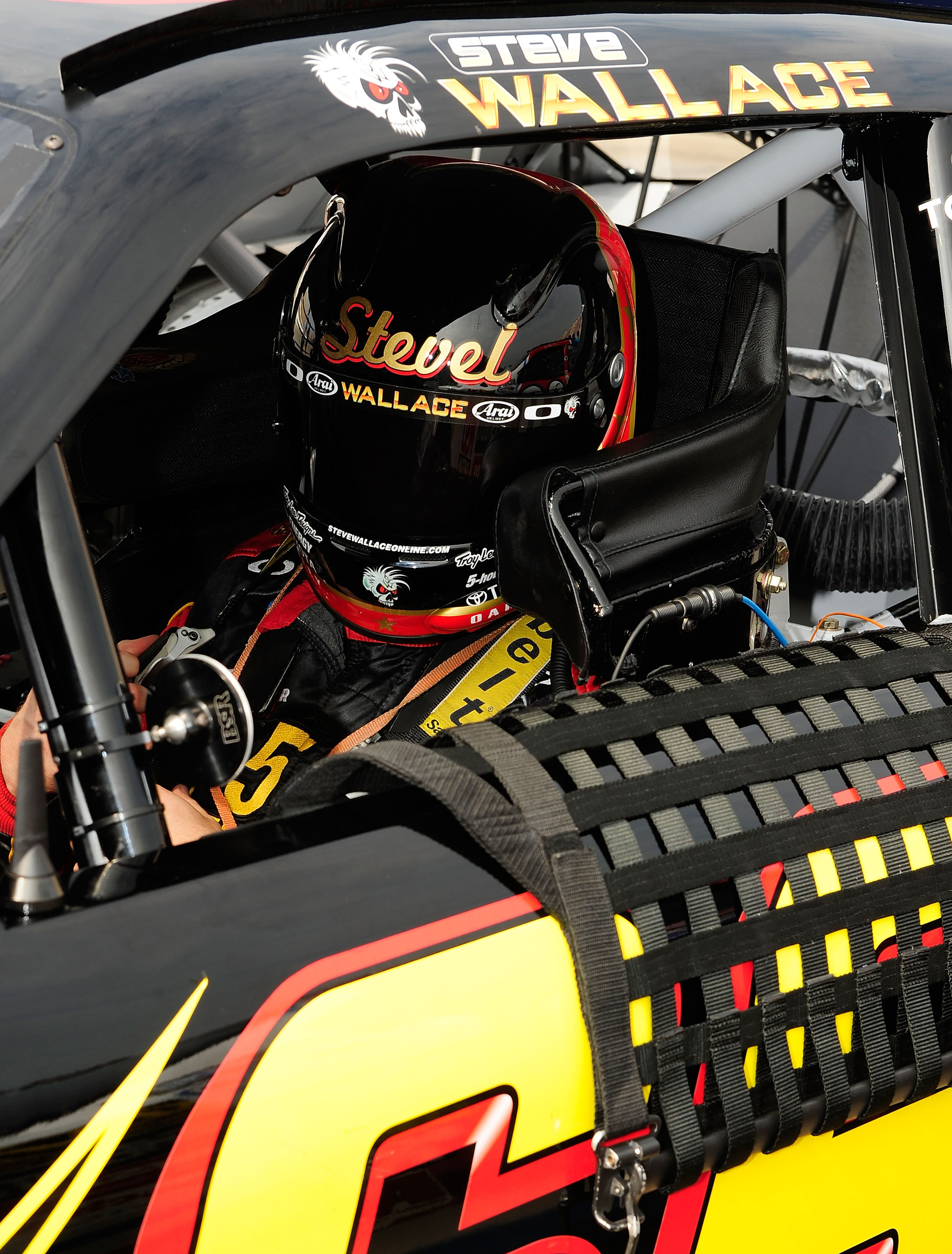 BROOKLYN, MI - AUGUST 14:  Steve Wallace, driver of the 5-hour Energy Toyota, sits in his car during qualifying for the NASCAR Nationwide Series CARFAX 250 at Michigan International Speedway on August 14, 2010 in Brooklyn, Michigan.  (Photo by Rusty Jarre