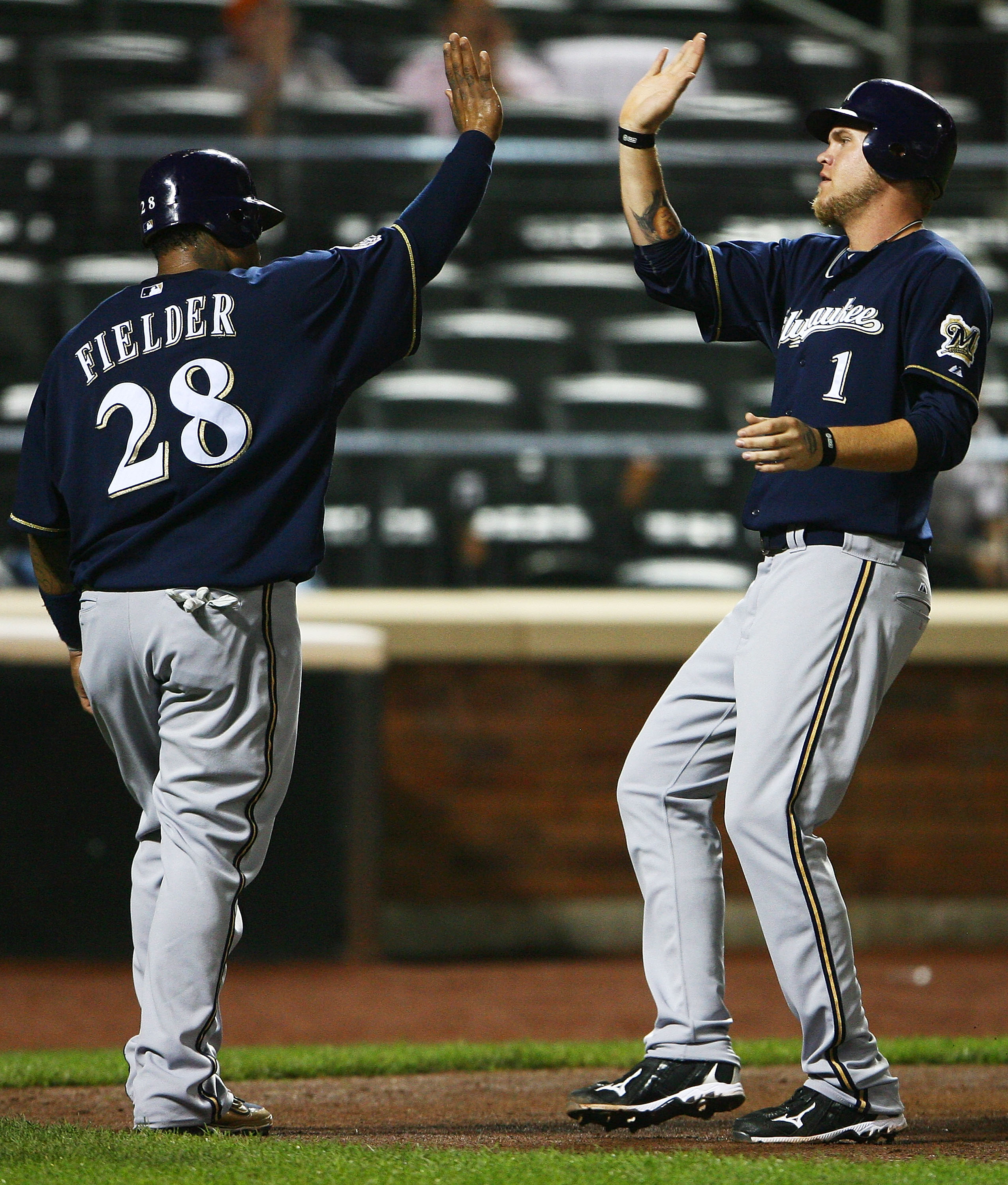 NEW YORK - SEPTEMBER 30:  Prince Fielder #28 (L) and Corey Hart #1 of the Milwaukee Brewers celebrate after both scoring off Lorenzo Cain's double in the fifth inning against the New York Mets on September 30, 2010 at Citi Field in the Flushing neighborho