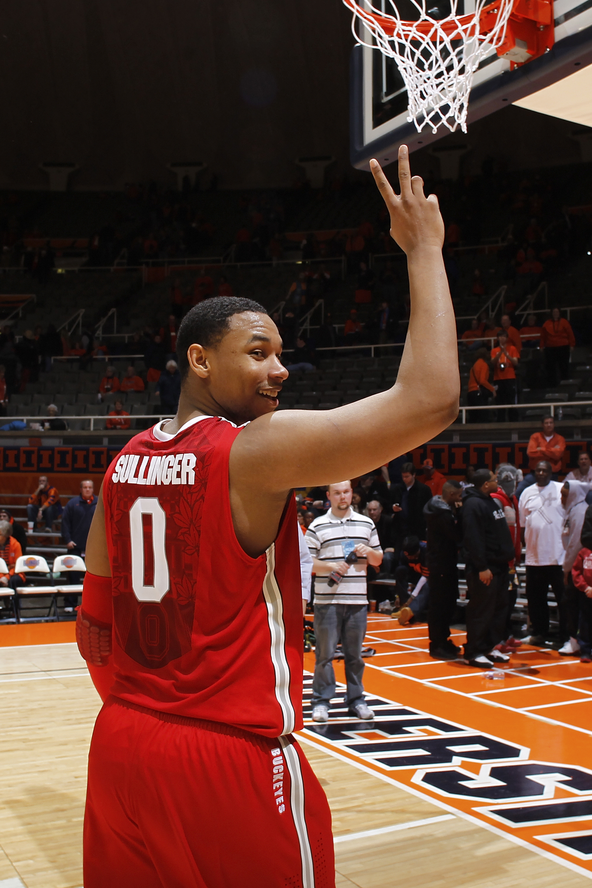 CHAMPAIGN, IL - JANUARY 22: Jared Sullinger #0 of the Ohio State Buckeyes gestures toward the student section as he leaves the floor after the game against the Illinois Fighting Illini at Assembly Hall on January 22, 2011 in Champaign, Illinois. Ohio Stat