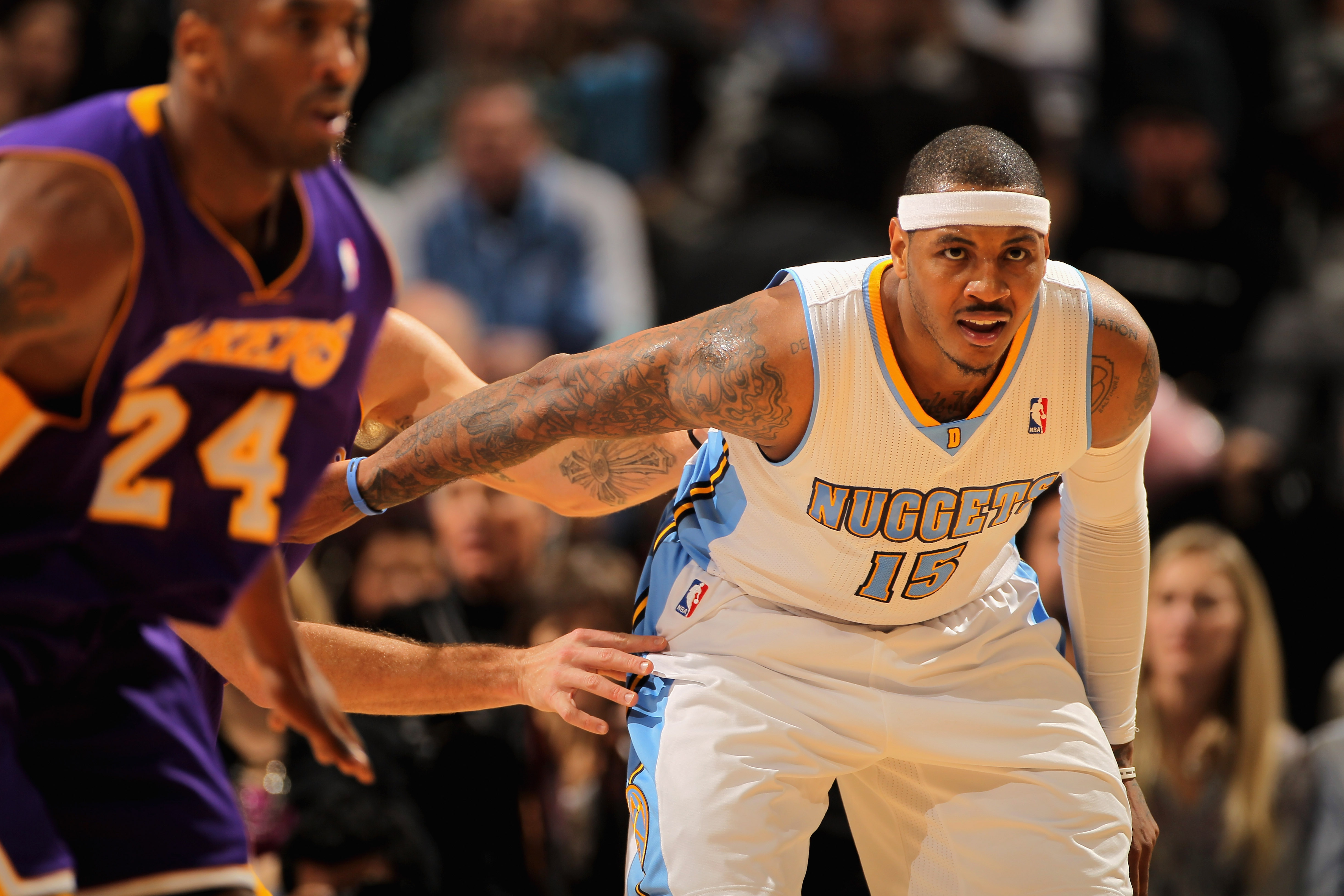 DENVER, CO - JANUARY 21:  Carmelo Anthony #15 of the Denver Nuggets gets open and lookls for the ball against the Los Angeles Lakers at the Pepsi Center on January 21, 2011 in Denver, Colorado. The Lakers defeated the Nuggets 107-97. NOTE TO USER: User ex
