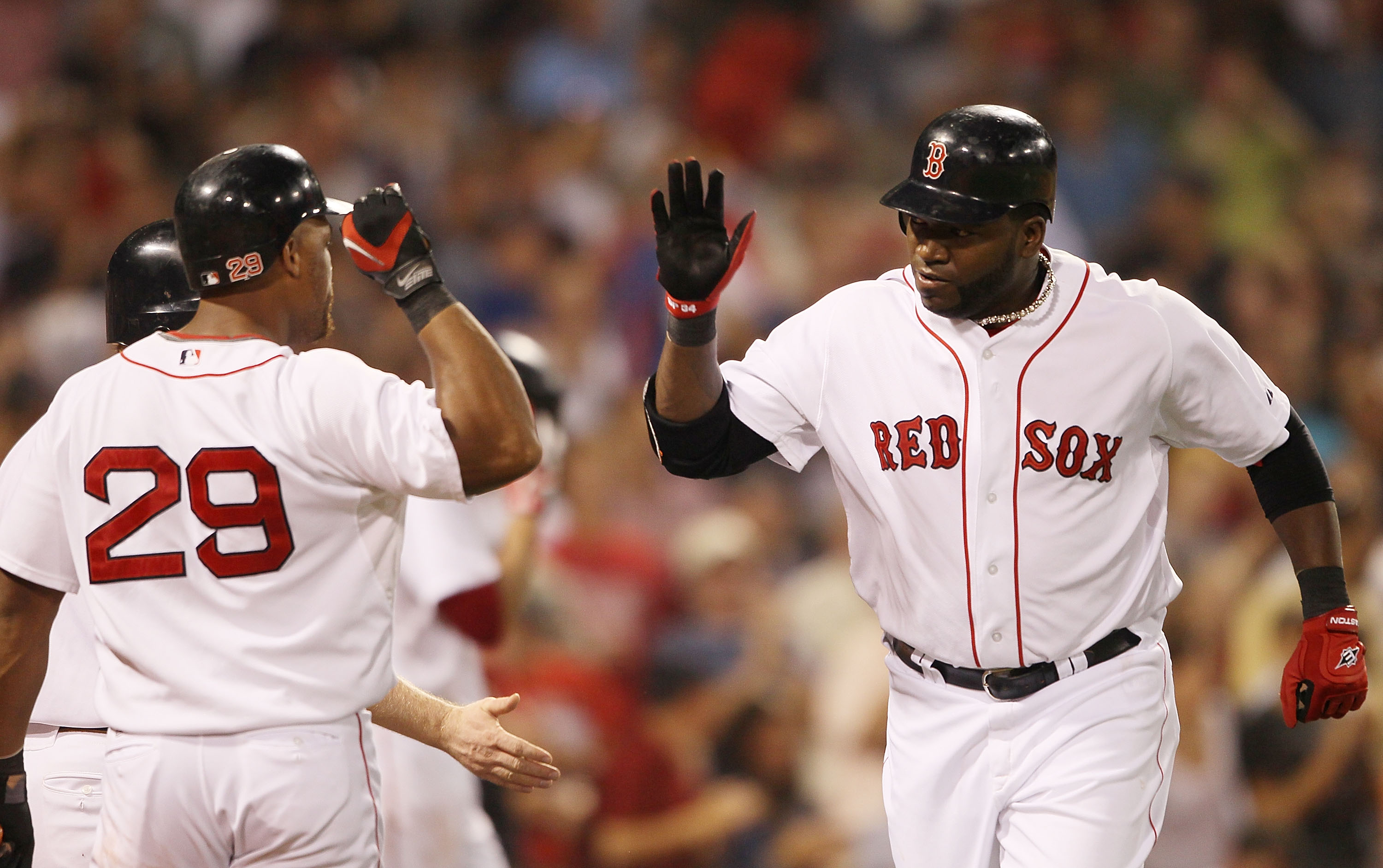 BOSTON - AUGUST 19:  David Ortiz #34  of the Boston Red Sox is congratulated by teammate Adrian Beltre #29 after Ortiz hit a solo home run in the fourth inning against of the Los Angeles Angels of Anaheim on August 19, 2010 at Fenway Park in Boston, Massa