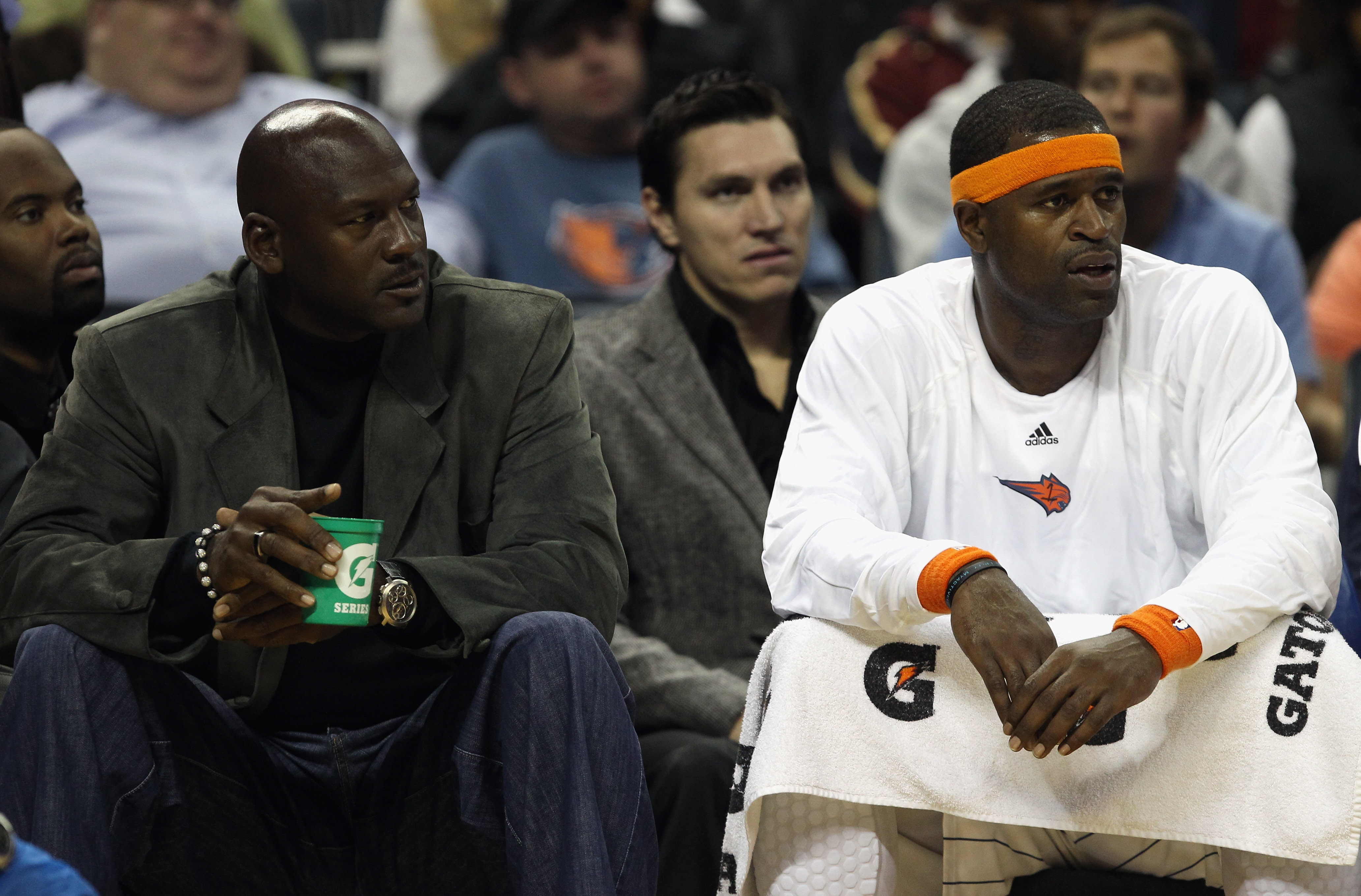 CHARLOTTE, NC - NOVEMBER 08:  Michael Jordan, owner of the Charlotte Bobcats, sits on the bench with Stephen Jackson #1 during their game against the San Antonio Spurs at Time Warner Cable Arena on November 8, 2010 in Charlotte, North Carolina.  NOTE TO U