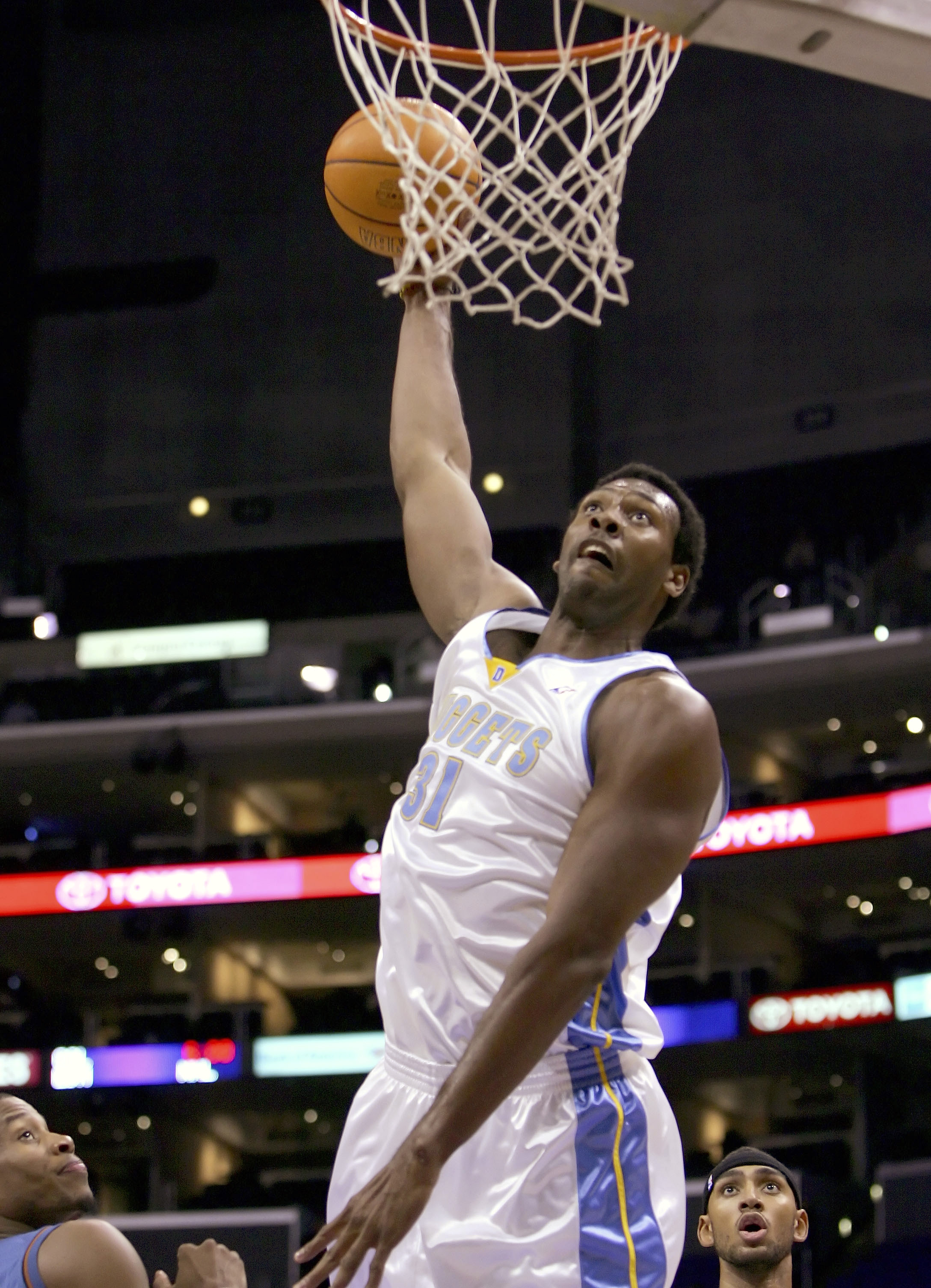 LOS ANGELES - OCTOBER 21:  Nene Hilario #31 of the Denver Nuggets slam dunks against the Washington Wizards on October 21, 2005 at Staples Center in Los Angeles, California. NOTE TO USER: User expressly acknowledges and agrees that, by downloading and or