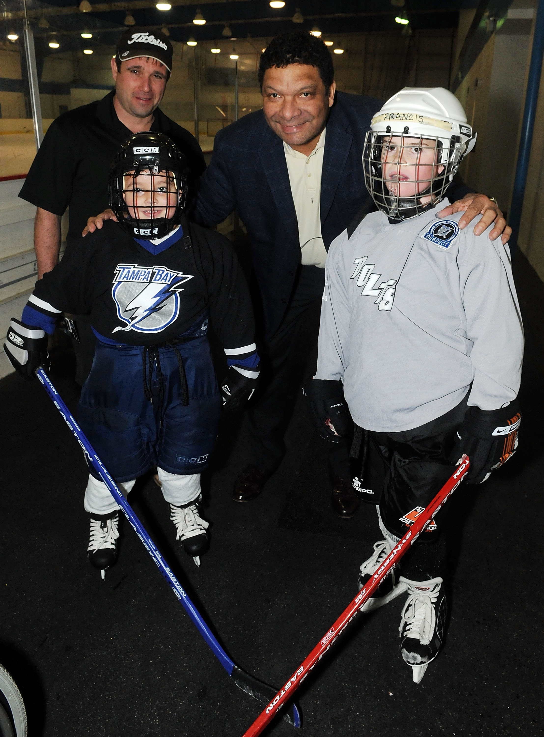 DAYTONA BEACH, FL - MARCH 06:  Tony McKegney (C) pose with kids during the Florida hockey day at the  Daytona Ice Arena on March 6, 2010 in Daytona Beach, Florida.  (Photo by Gerardo Mora/Getty Images for NHL)