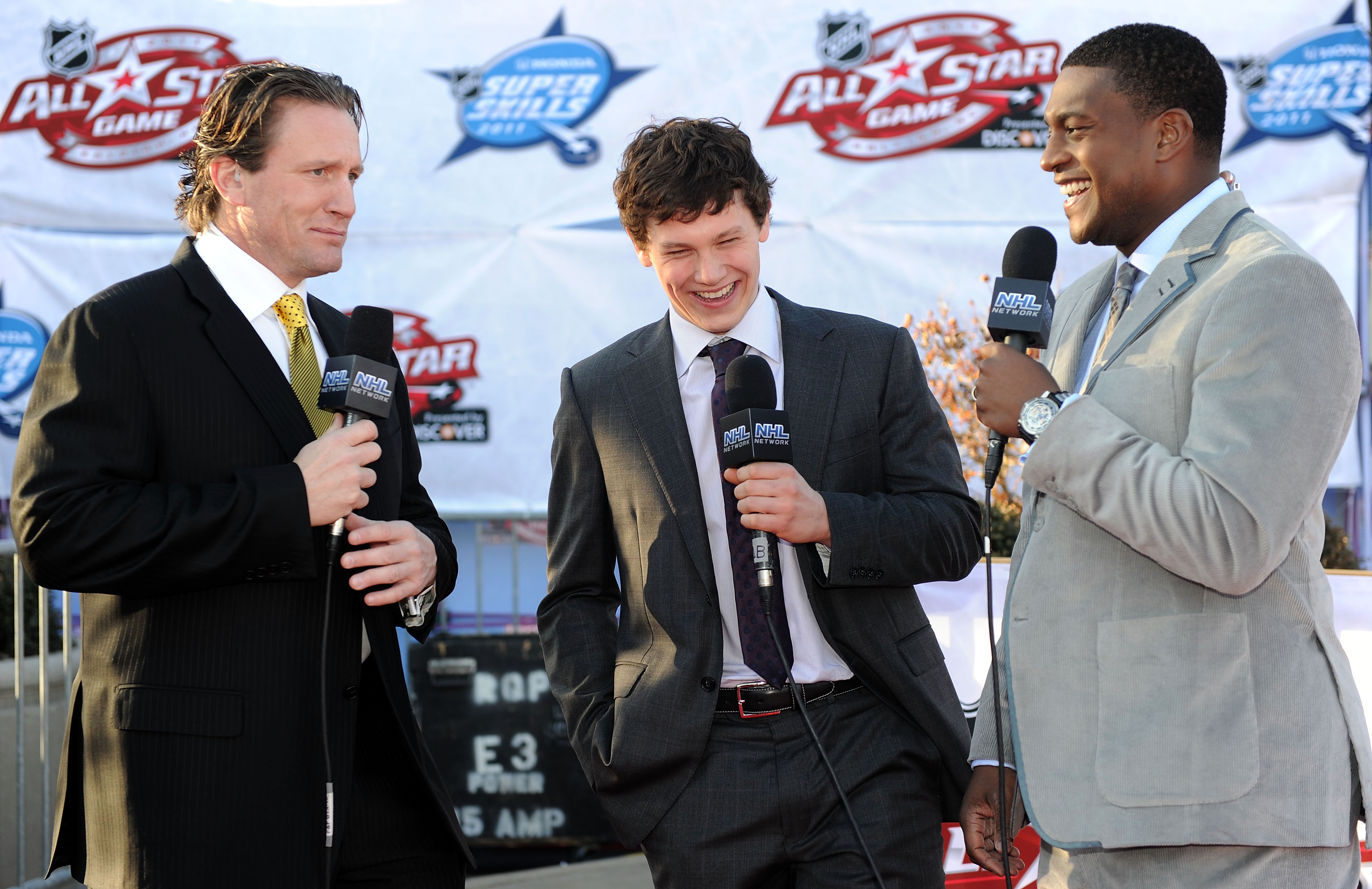 RALEIGH, NC - JANUARY 29:  Jeff Skinner (C) of the Carolina Hurricanes for Team Staal speaks to Kevin Weekes (R) and Jeremy Roenick as he arrives at the NHL All-Star red carpet part of 2011 NHL All-Star Weekend on January 29, 2011 in Raleigh, North Caroli