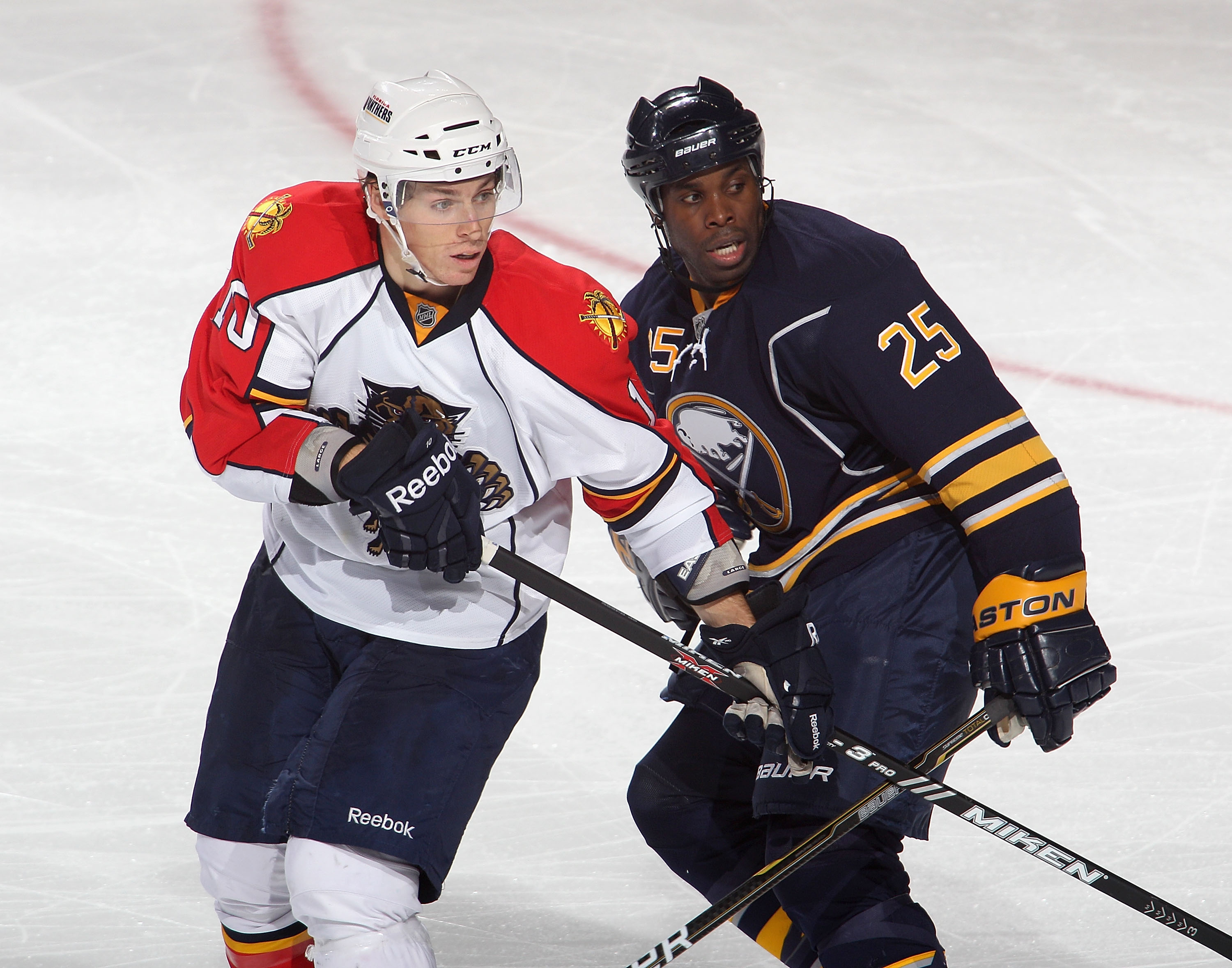 BUFFALO, NY - DECEMBER 23:  Mike Grier #25 of the Buffalo Sabres skates against  David Booth #10 of the Florida Panthers at HSBC Arena on December 23, 2010 in Buffalo, New York.  (Photo by Rick Stewart/Getty Images)