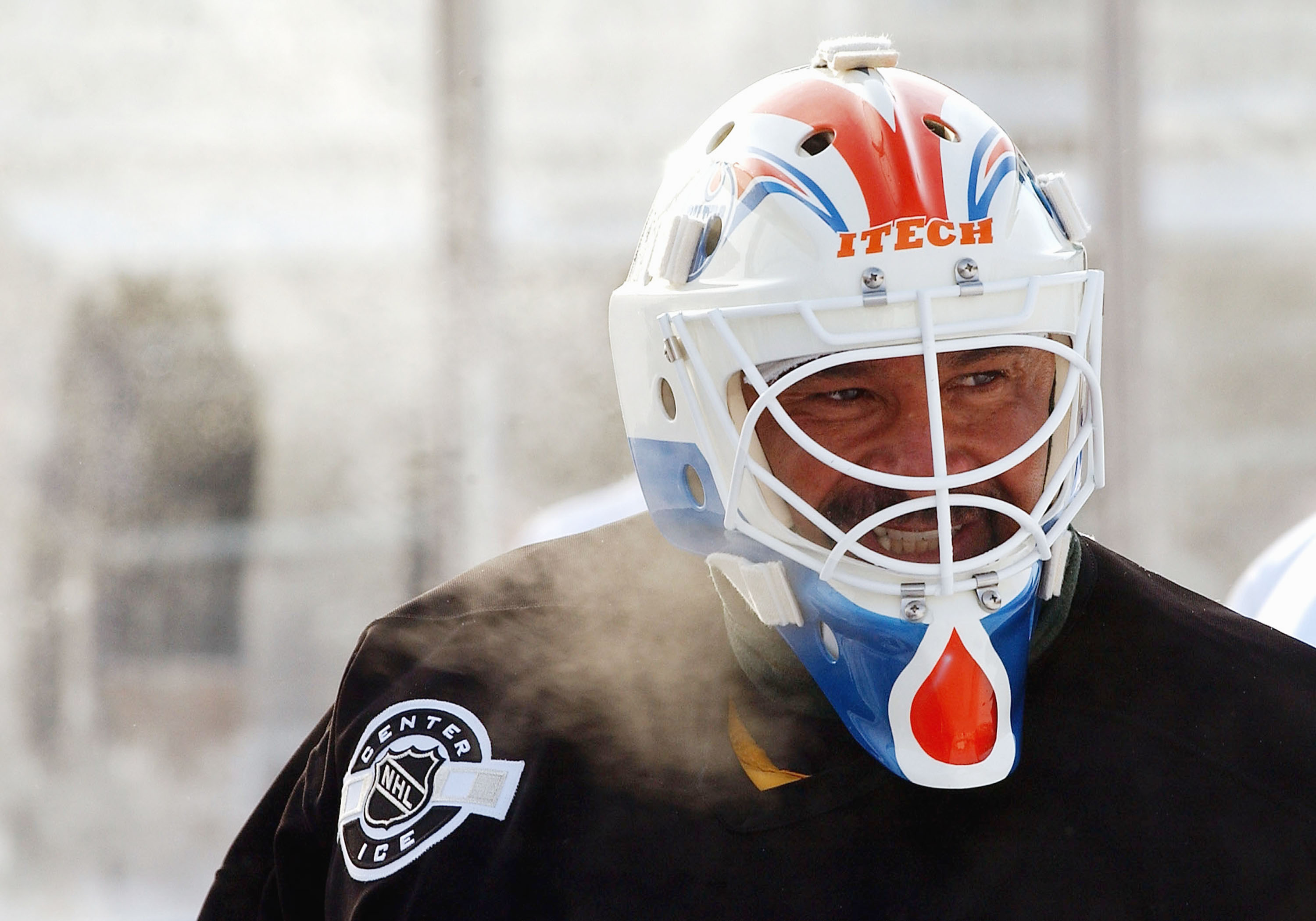 EDMONTON - NOVEMBER 21:  Grant Fuhr #31 of the Edmonton Oilers Alumni takes a moment to catch his breath at outdoor practice in very cold temperatures November 21, 2003 in Edmonton, Alberta. Practice is in preperation for the upcoming Heritage Classic hoc