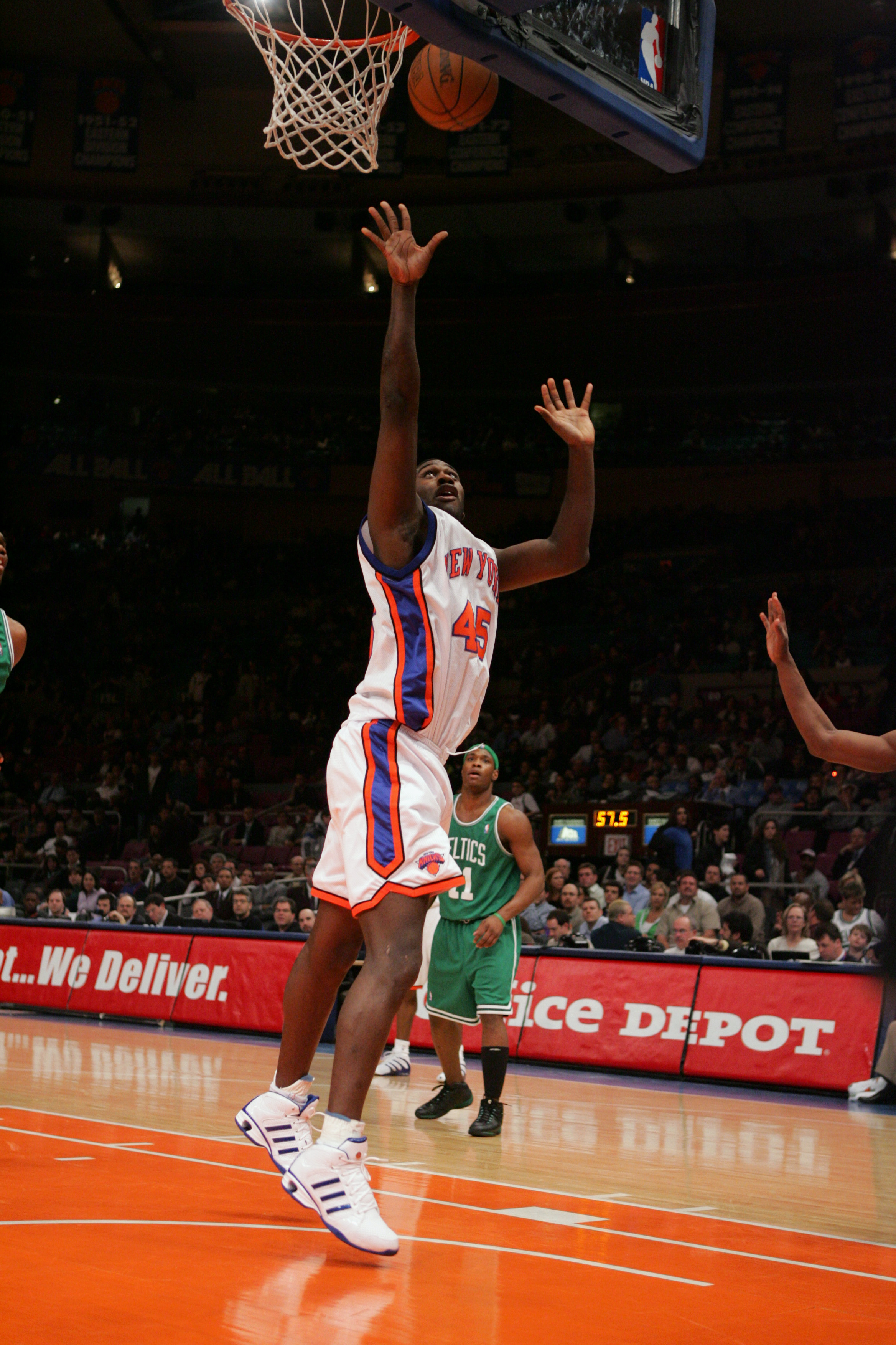 86a8d47e1 NEW YORK - MARCH 23  Jackie Butler  45 of the New York Knicks shoots