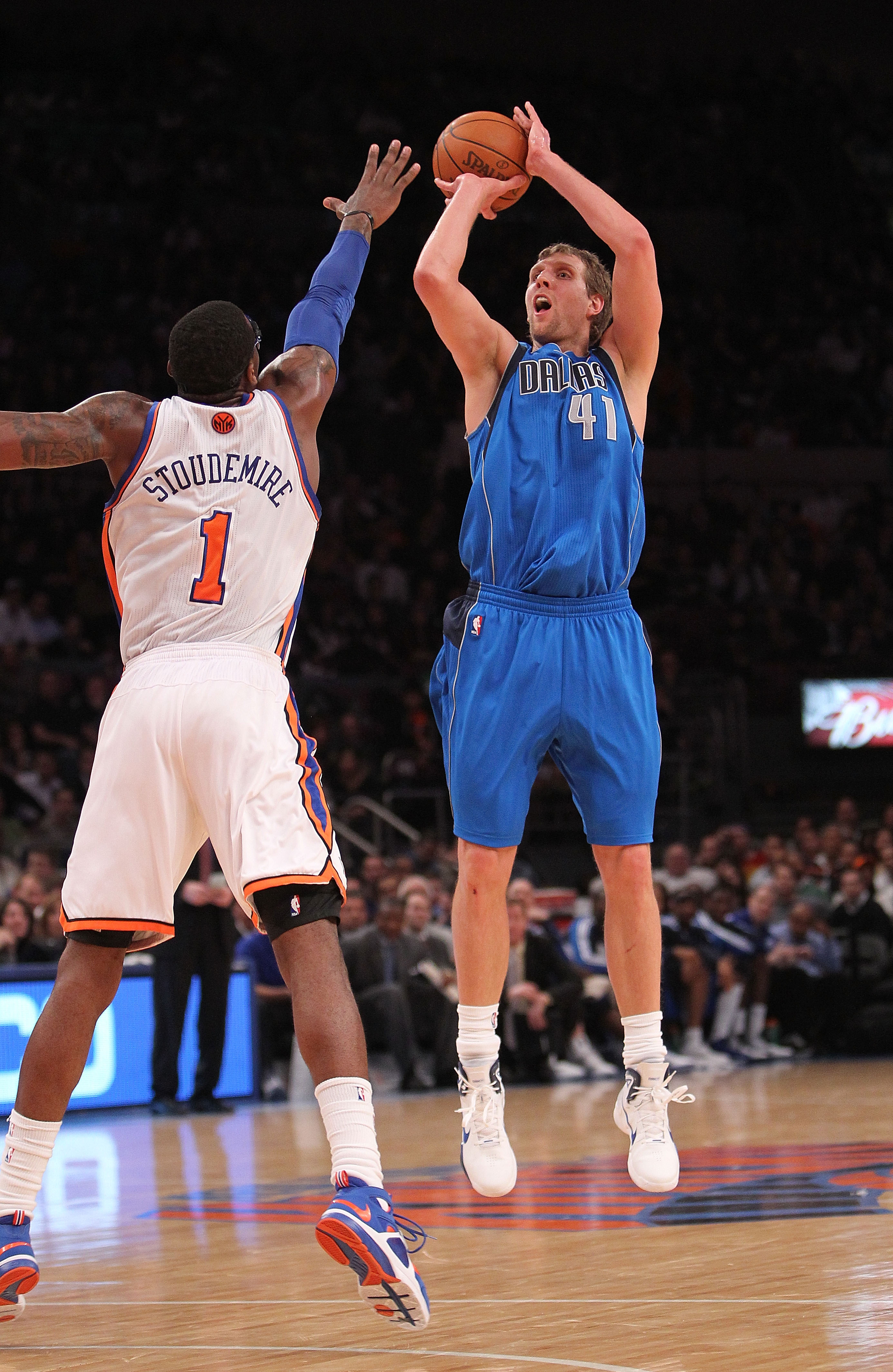 NEW YORK, NY - FEBRUARY 02: Dirk Nowitzki #41 of the Dallas Mavericks shoots over Amar'e Stoudemire #1 of the New York Knicks at Madison Square Garden on February 2, 2011 in New York City. NOTE TO USER: User expressly acknowledges and agrees that, by down
