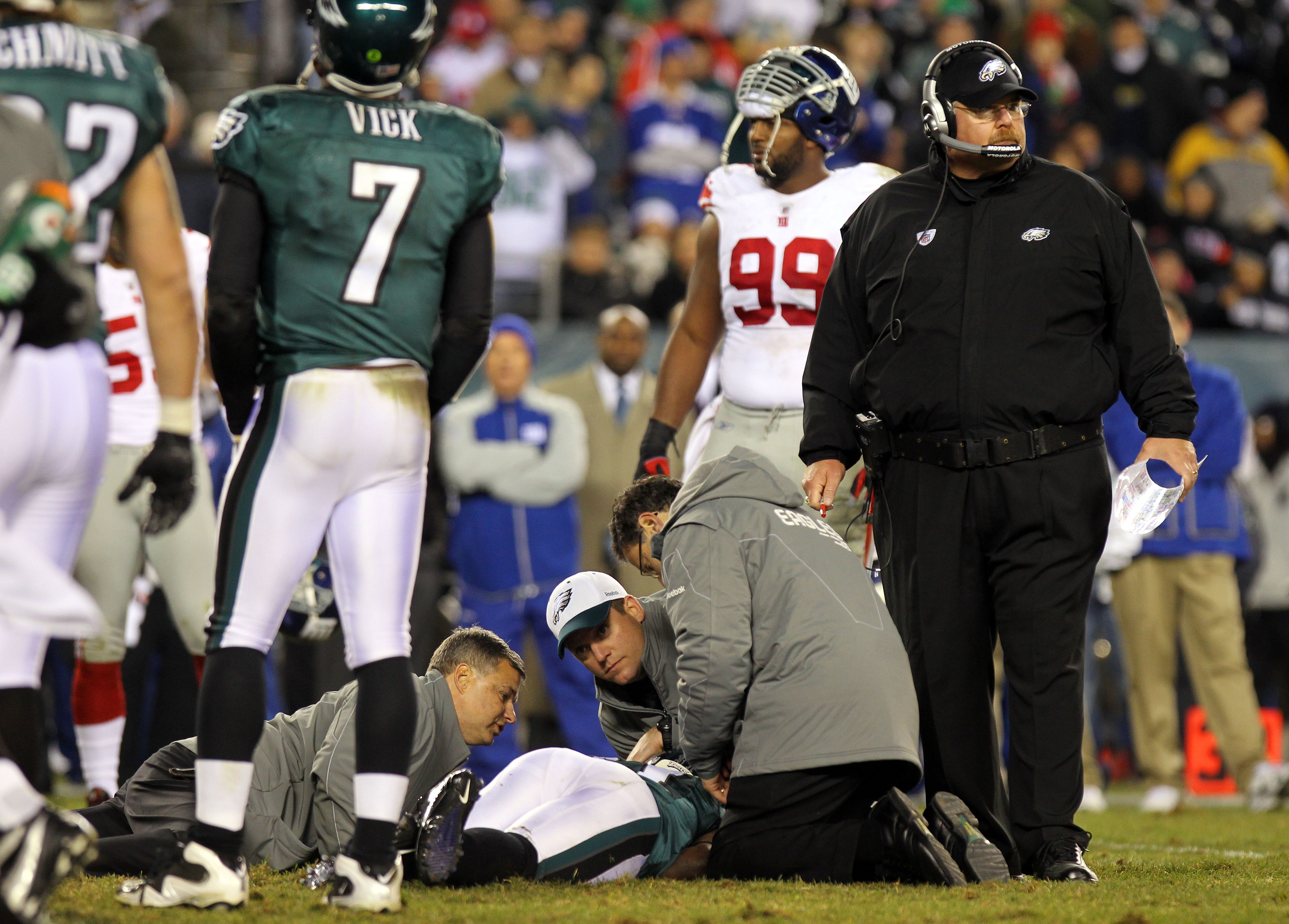 PHILADELPHIA - NOVEMBER 21: Ellis Hobbs #31 of the Philadelphia Eagles is tended to after getting injured on a kickoff returns against the New York Giants as head coach Andy Reid (R) looks on at Lincoln Financial Field on November 21, 2010 in Philadelphia