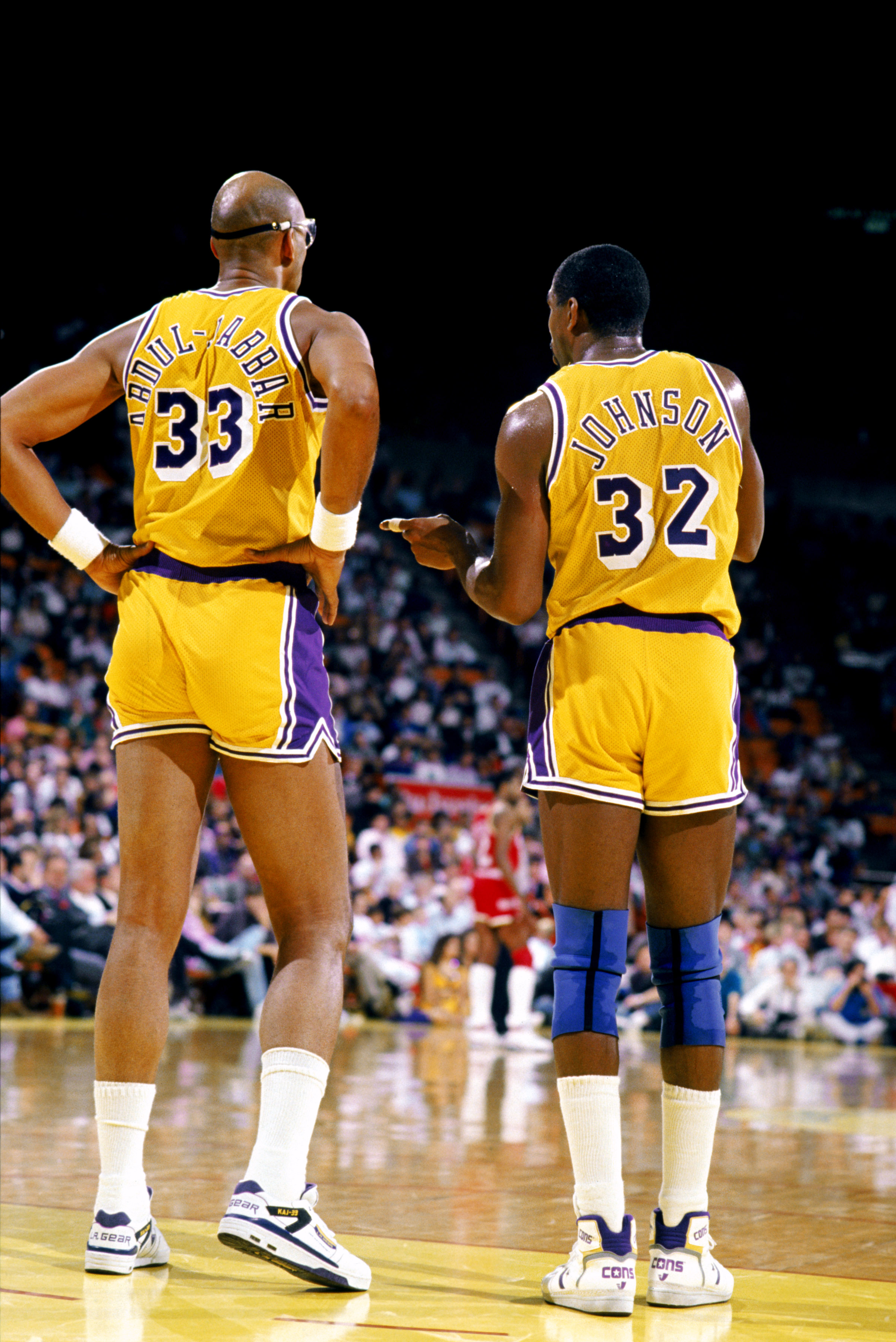 LOS ANGELES - 1988:  Kareem Abdul-Jabbar #33 of the Los Angeles Lakers listens to Magic Johnson #32 during an NBA game at the Great Western Forum in Los Angeles, California in 1988. (Photo by Mike Powell/Getty Images)