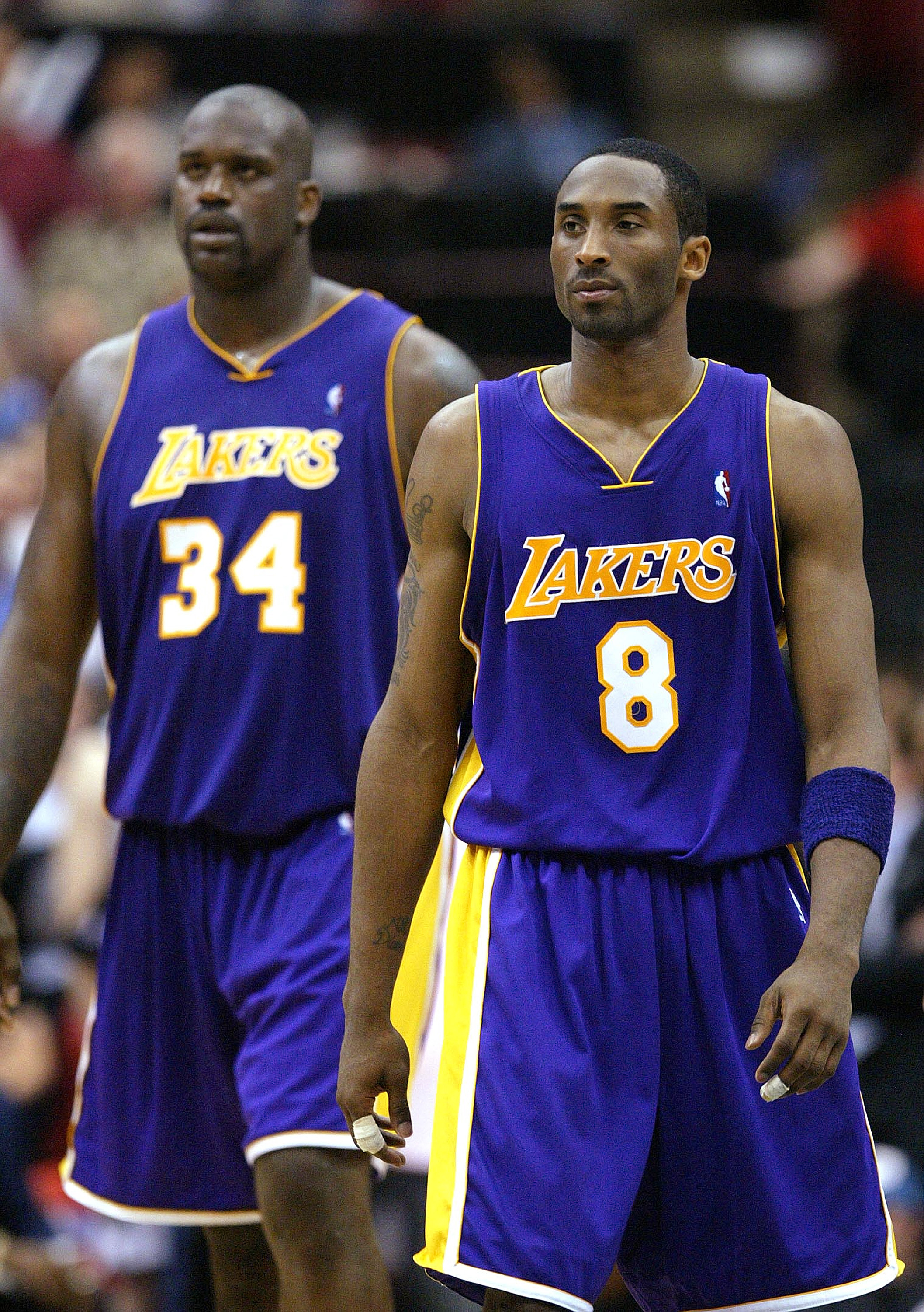 MINNEAPOLIS - MAY 29:  Kobe Bryant #8 and Shaquille O'Neal #34 of the Los Angeles Lakers walk upcourt in the fourth quarter of Game five of the Western Conference Finals against the Minnesota Timberwolves during the 2004 NBA Playoffs on May 29, 2004 at Ta