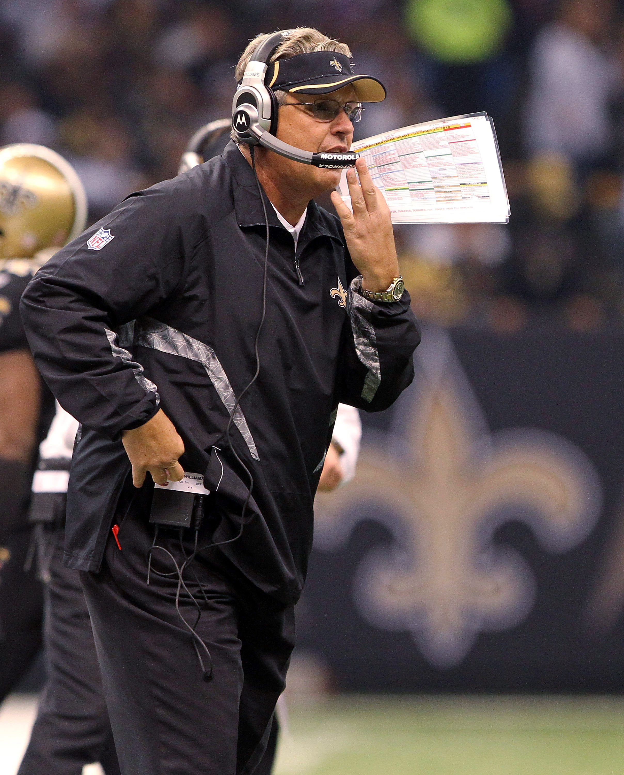 NEW ORLEANS, LA - OCTOBER 31: Defensive coordinator Gregg Williams of the New Orleans Saints talks to the defense from the sidelines during the game against the Pittsburgh Steelers at the Louisiana Superdome on October 31, 2010 in New Orleans, Louisiana.