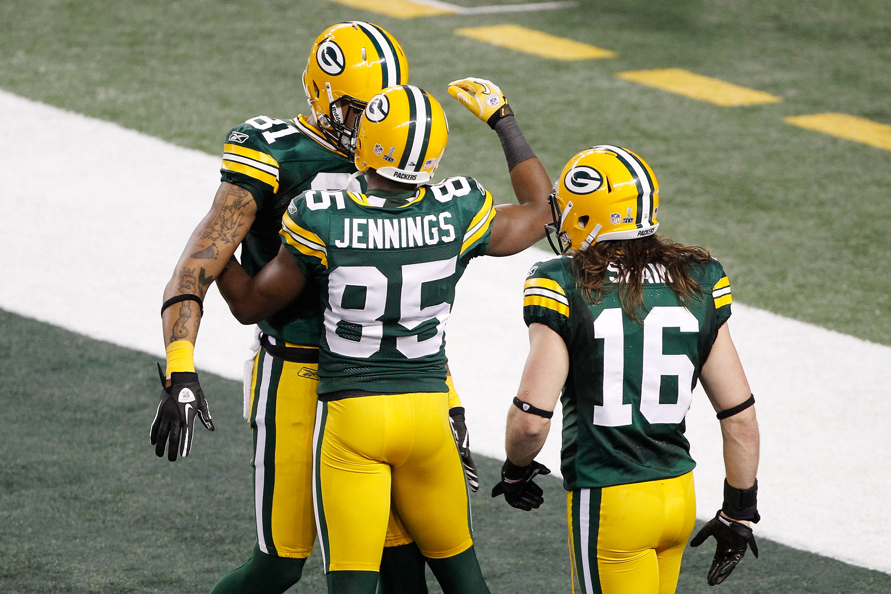 ARLINGTON, TX - FEBRUARY 06:  Greg Jennings #85 of the Green Bay Packers celebrates a fourth quarter touchdown against the Pittsburgh Steelers with teammates Andrew Quarless #81 and Brett Swain #16 during Super Bowl XLV at Cowboys Stadium on February 6, 2