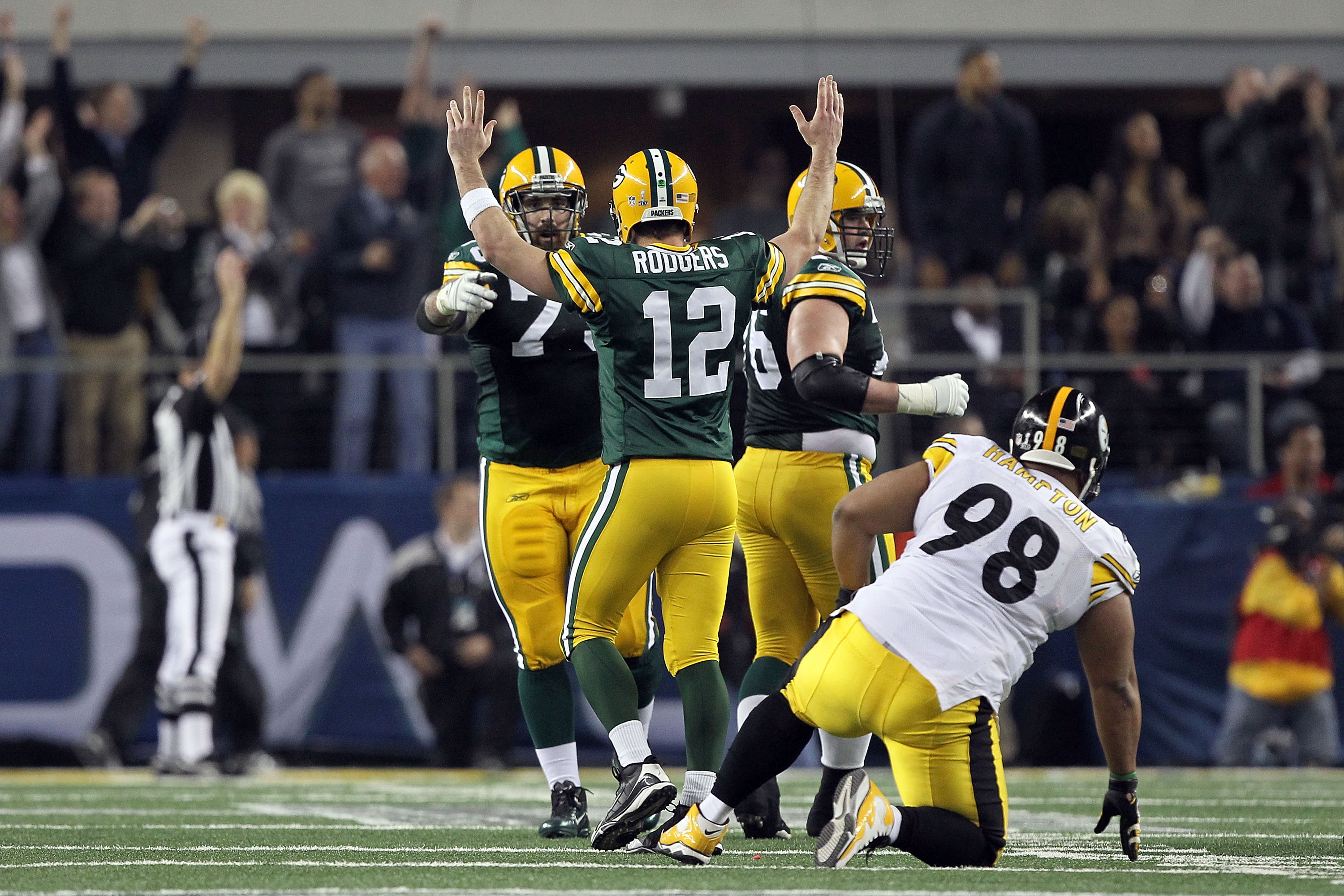 ARLINGTON, TX - FEBRUARY 06: Aaron Rodgers #12 of the Green Bay Packers celebrates late in the game against the Pittsburgh Steelers during Super Bowl XLV at Cowboys Stadium on February 6, 2011 in Arlington, Texas.  (Photo by Al Bello/Getty Images)