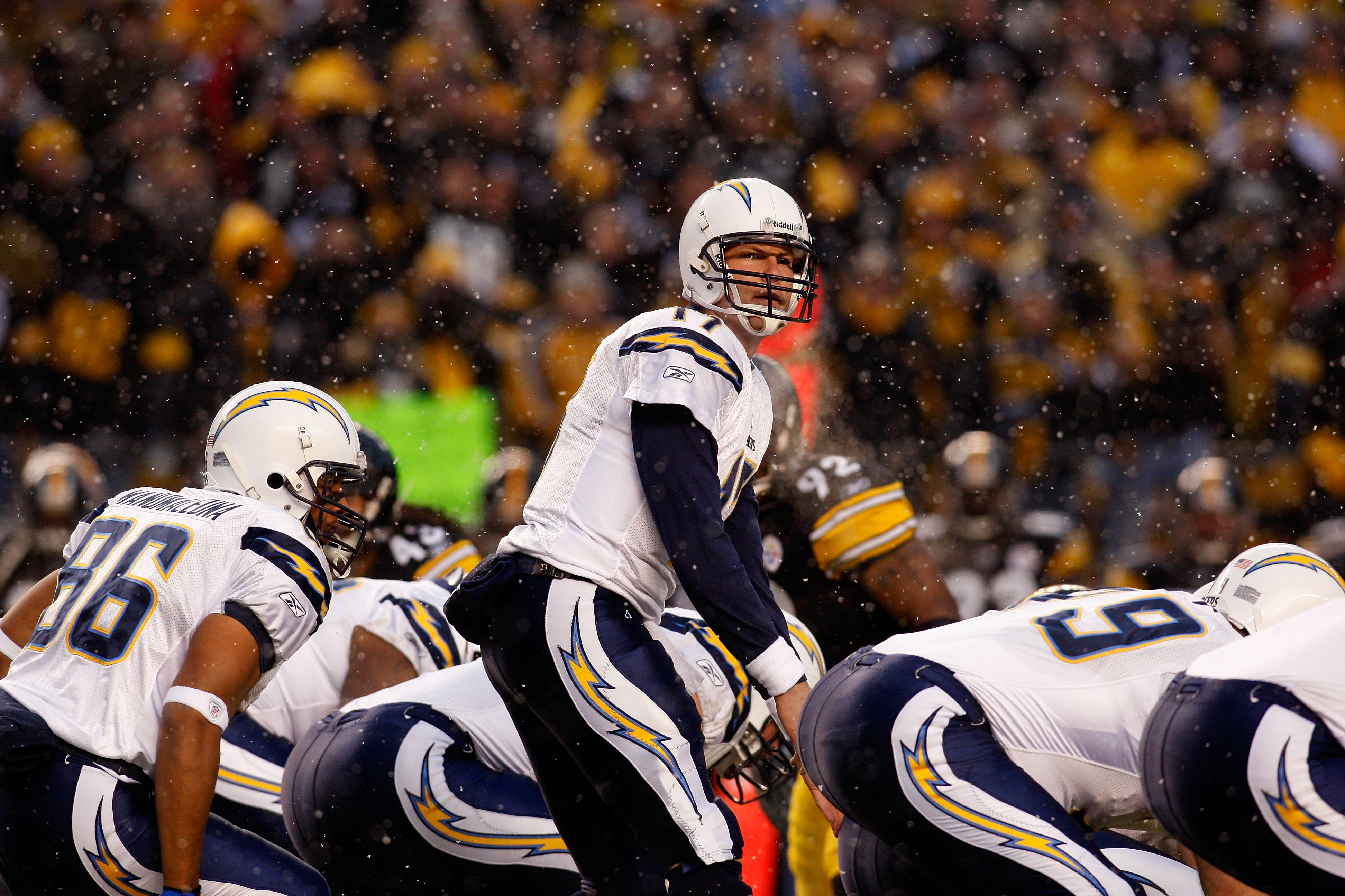 PITTSBURGH - JANUARY 11:  Snow falls as Philip Rivers #17 of the San Diego Chargers calls out signals at the line of scrimmage against the Pittsburgh Steelers during their AFC Divisional Playoff Game on January 11, 2009 at Heinz Field in Pittsburgh, Penns