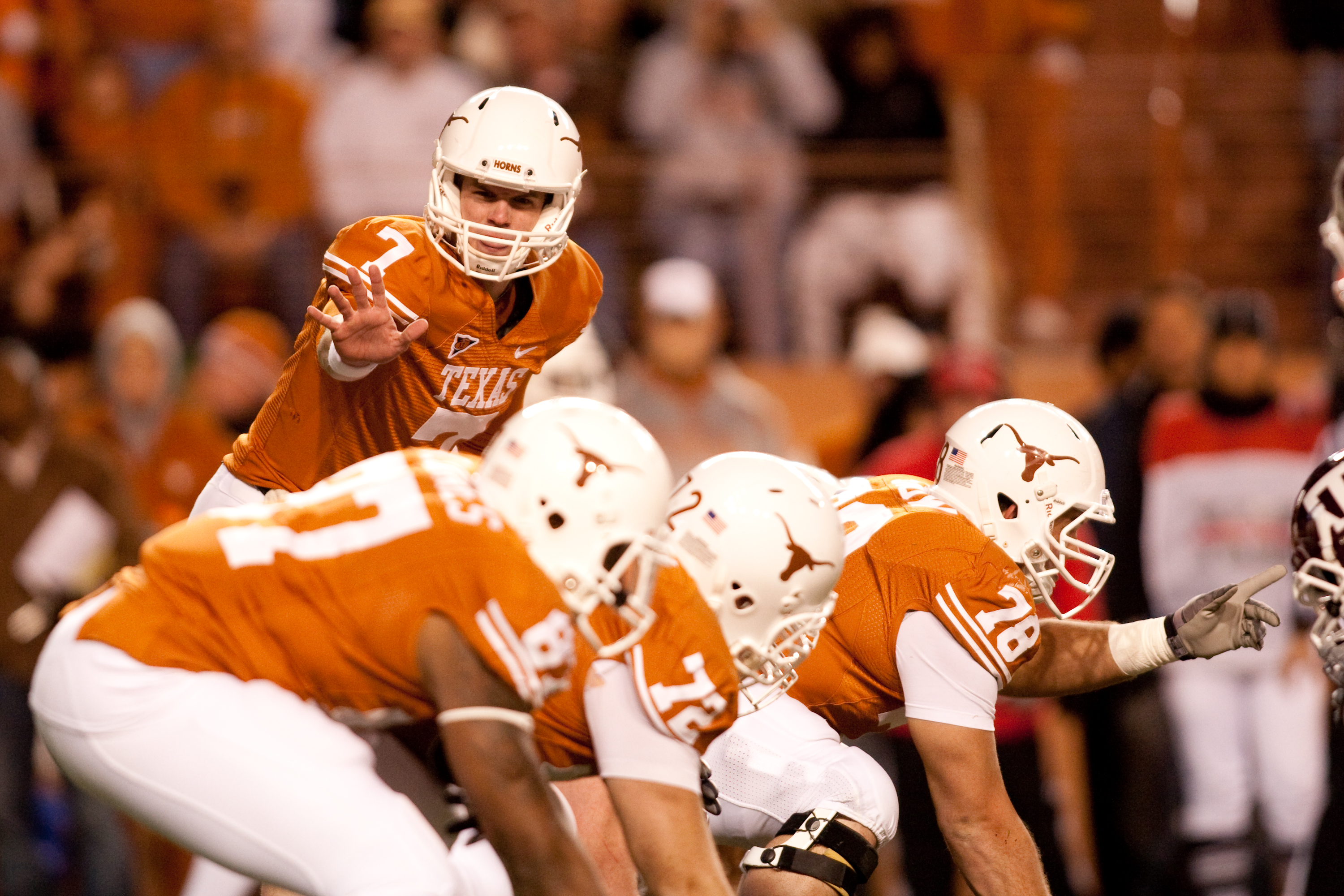 AUSTIN, TX - NOVEMBER 25:  University of Texas quarterback Garrett Gilbert #7 calls a play during the first half against Texas A&M at Darrell K. Royal-Texas Memorial Stadium on November 25, 2010 in Austin, Texas. (Photo by Darren Carroll/Getty Images)