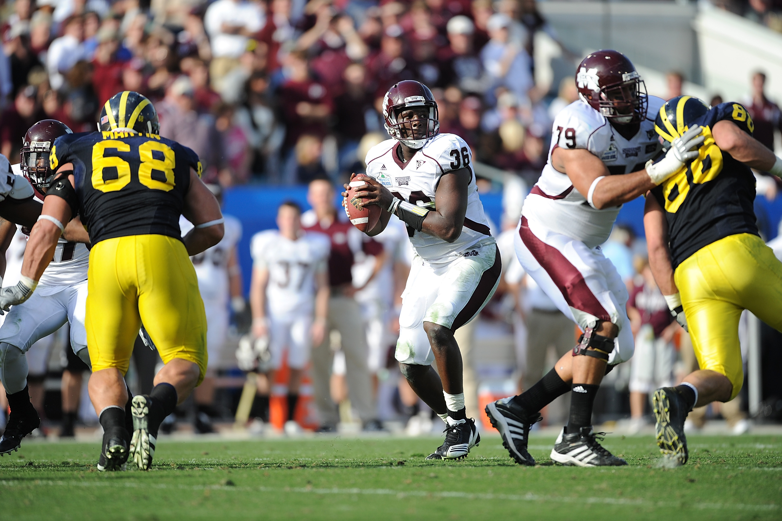 JACKSONVILLE, FL - JANUARY 01:  Quarterback Chris Relf #36 of the Mississippi State Bulldogs passes against the Michigan Wolverines during the Gator Bowl at EverBank Field on January 1, 2011 in Jacksonville, Florida  (Photo by Rick Dole/Getty Images)