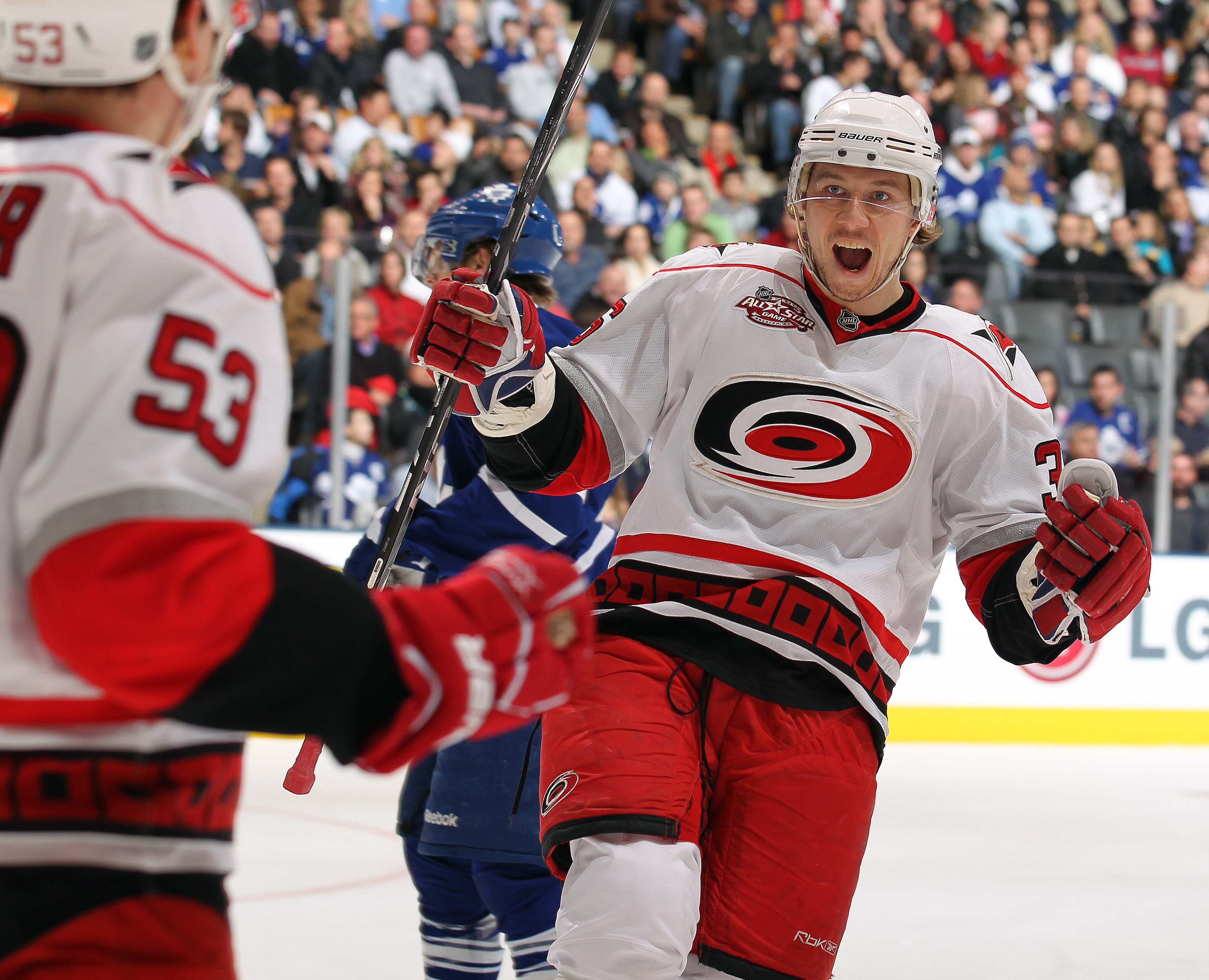 TORONTO,ON - DECEMBER 28:  Jussi Jokinen #36 of the Carolina Hurricanes congratulates teammate Jeff Skinner #53 on his goal in a game against the Toronto Maple Leafs on December 28, 2010 at the Air Canada Centre in Toronto, Ontario. (Photo by Claus Anders