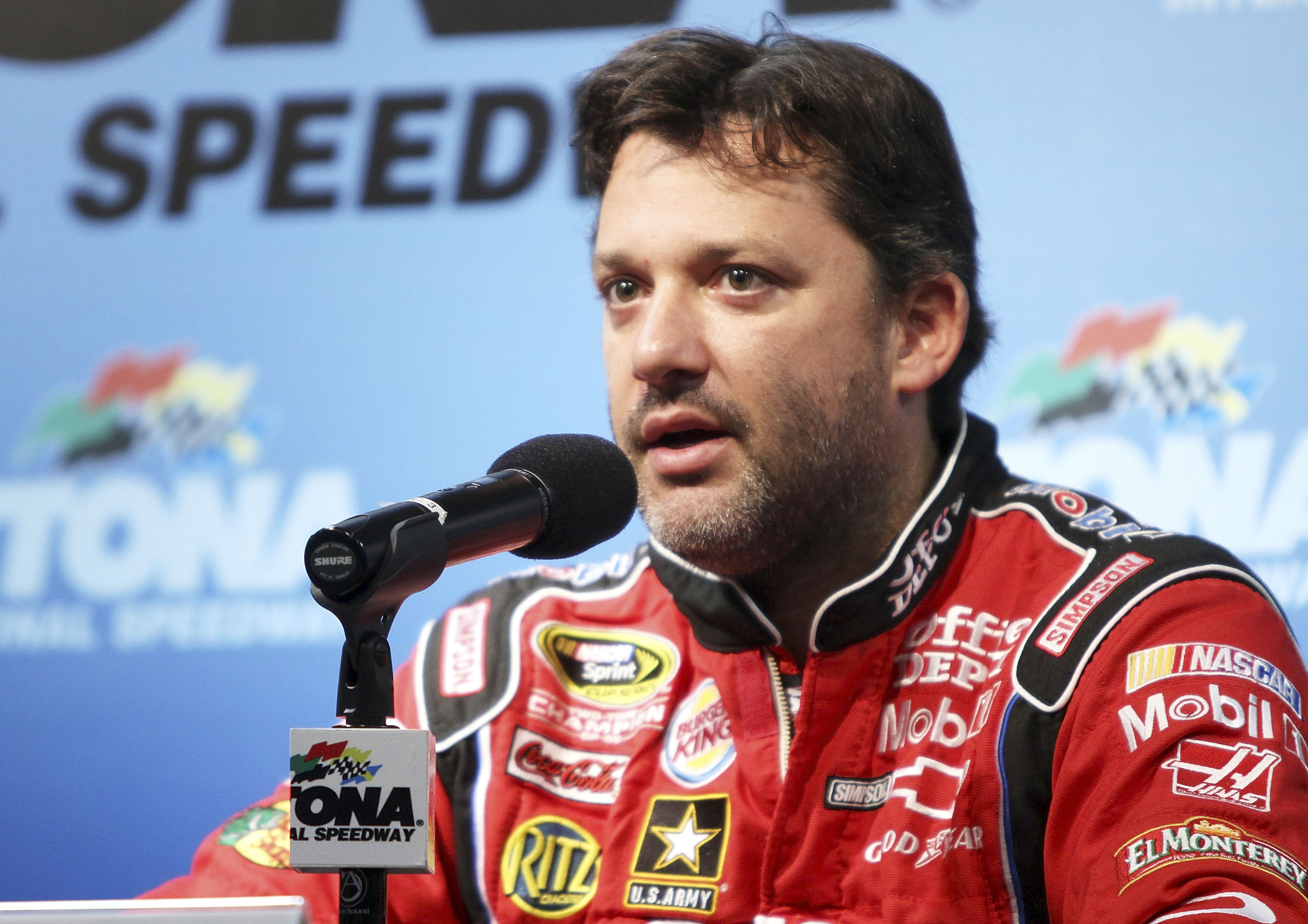 Tony Stewart had to answer difficult questions upon his return from Australia.