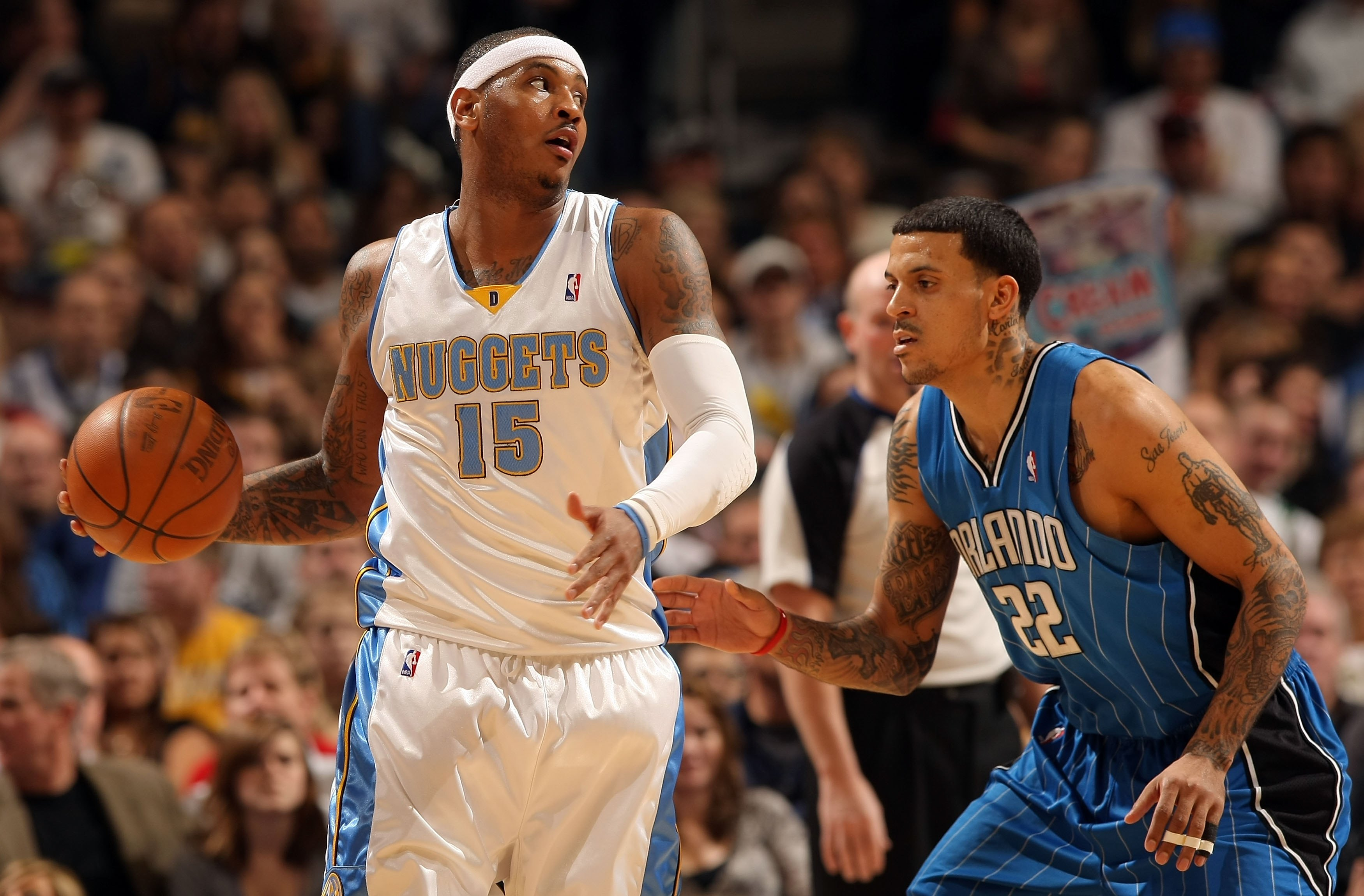 DENVER - JANUARY 13:  Carmelo Anthony #15 of the Denver Nuggets controls the ball against Matt Barnes #22 of the Orlando Magic during NBA action at Pepsi Center on January 13, 2010 in Denver, Colorado. The Nuggets defeated the Magic 115-97. NOTE TO USER: