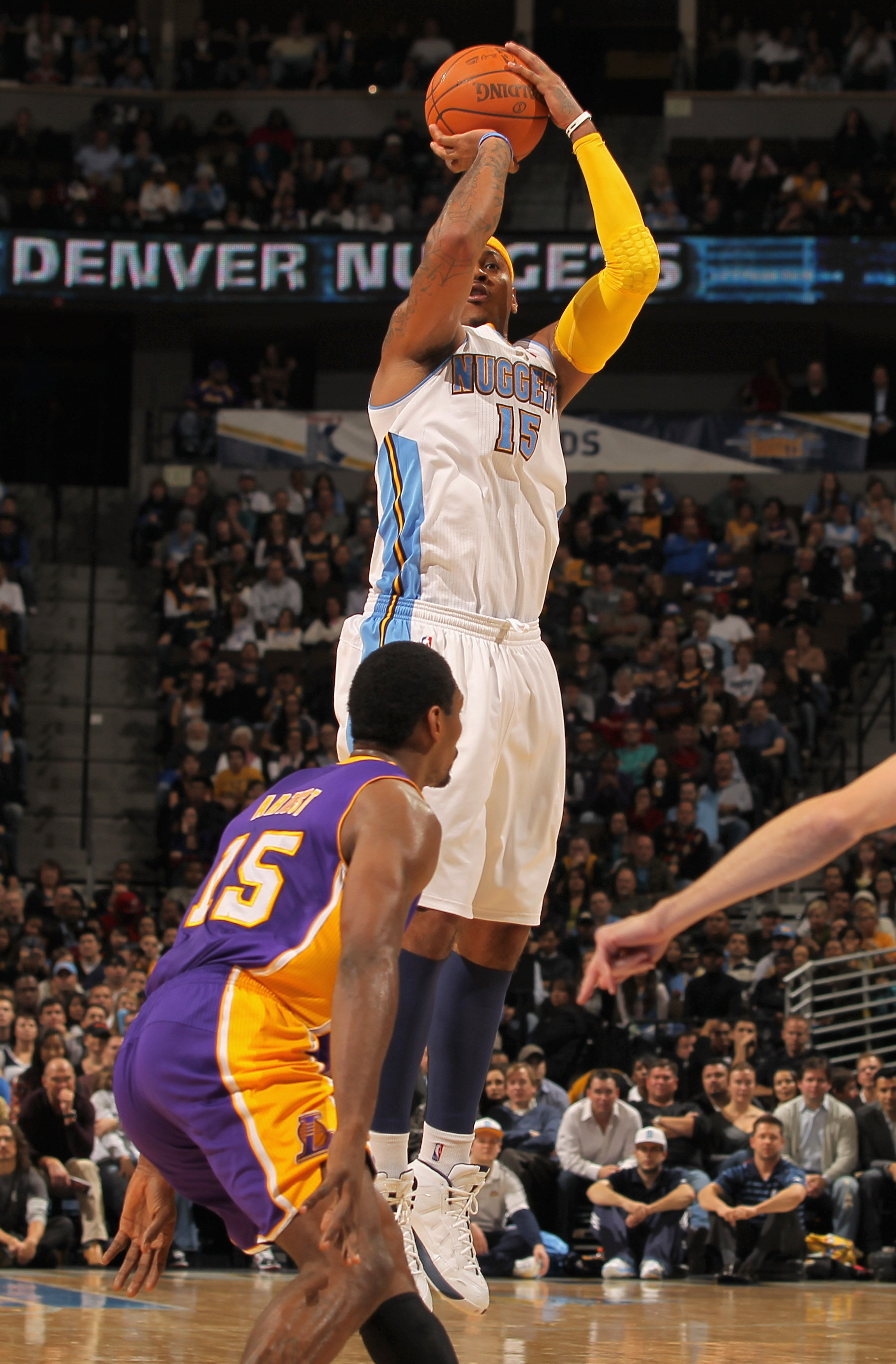 DENVER - NOVEMBER 11:  Carmelo Anthony #15 of the Denver Nuggets takes a shot over Ron Artest #15 of the Los Angeles Lakers at the Pepsi Center on November 11, 2010 in Denver, Colorado. The Nuggets defeated the Lakers 118-112.  NOTE TO USER: User expressl