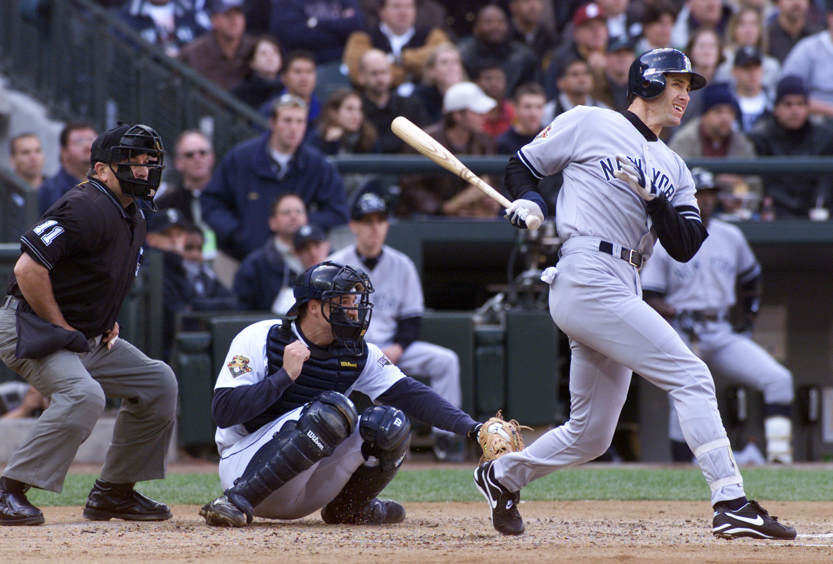 SEATTLE - OCTOBER 17 Oct 2001: Paul O'Neill #21 of the New York Yankees hits a home run off of Aaron Sele #30 of the Seattle Mariners during game one of the American League Championship Series playoffs on October 17, 2001 at SafeCo Field in Seattle, Washi