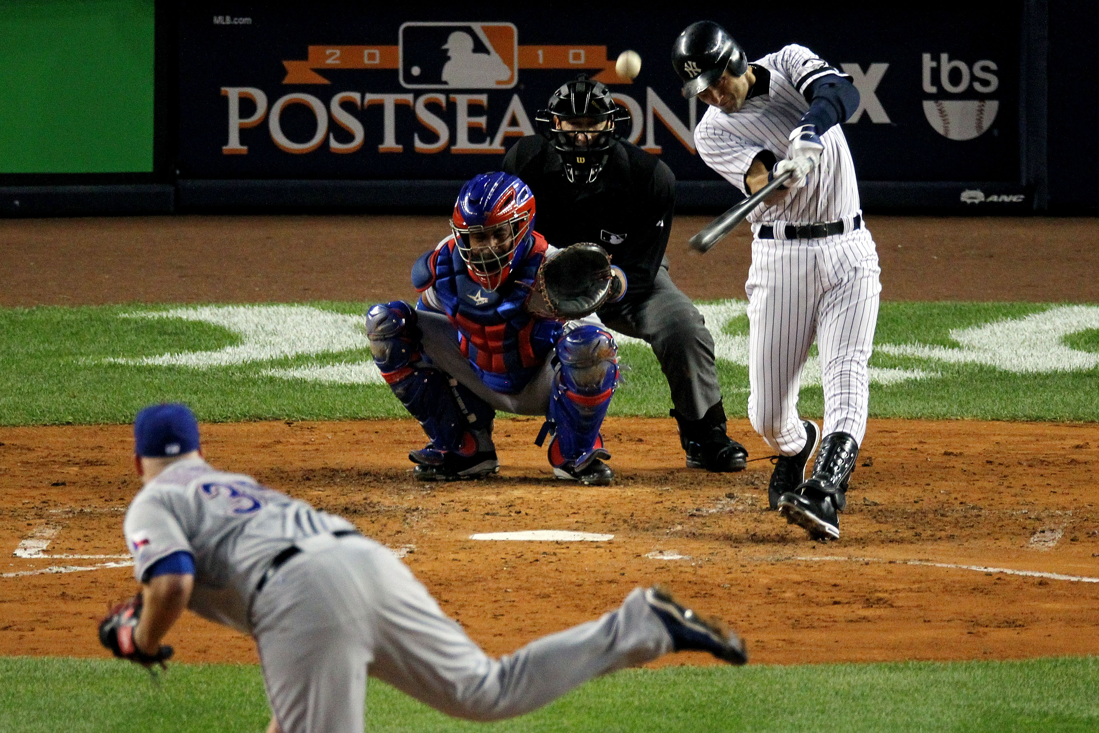 NEW YORK - OCTOBER 19:  Derek Jeter #2 of the New York Yankees hits a triple in the third inning against Tommy Hunter #35 of the Texas Rangers in Game Four of the ALCS during the 2010 MLB Playoffs at Yankee Stadium on October 19, 2010 in the Bronx borough