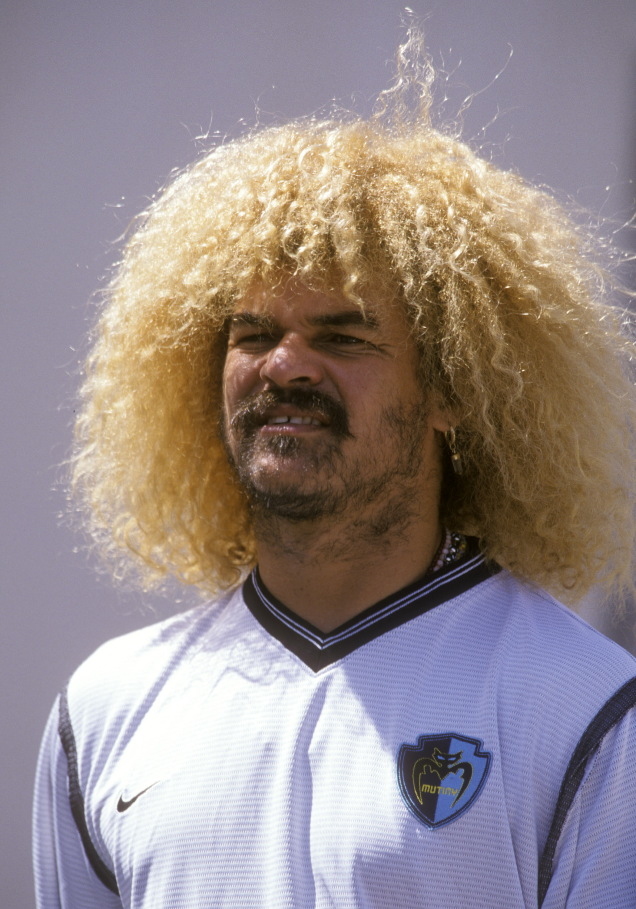 Soccer star Carlos Valderrama checks play during a soccer match in Tampa in June 2000. (Photo by Al Messerschmidt/WireImage)