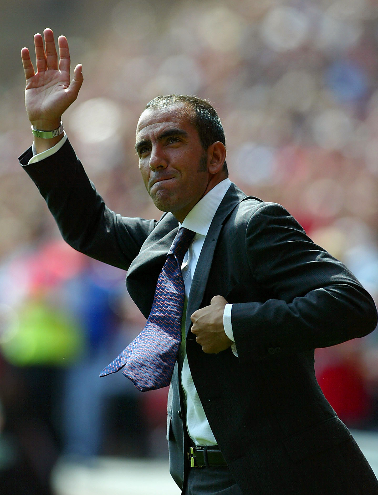 LONDON - AUGUST 17:  Paulo Di Canio of Charlton Athletic waves to the crowd prior to kick-off during the FA Barclaycard Premiership match between Charlton Athletic and Manchester City at The Valley on August 17, 2003 in London. (Photo by Phil Cole/Getty I