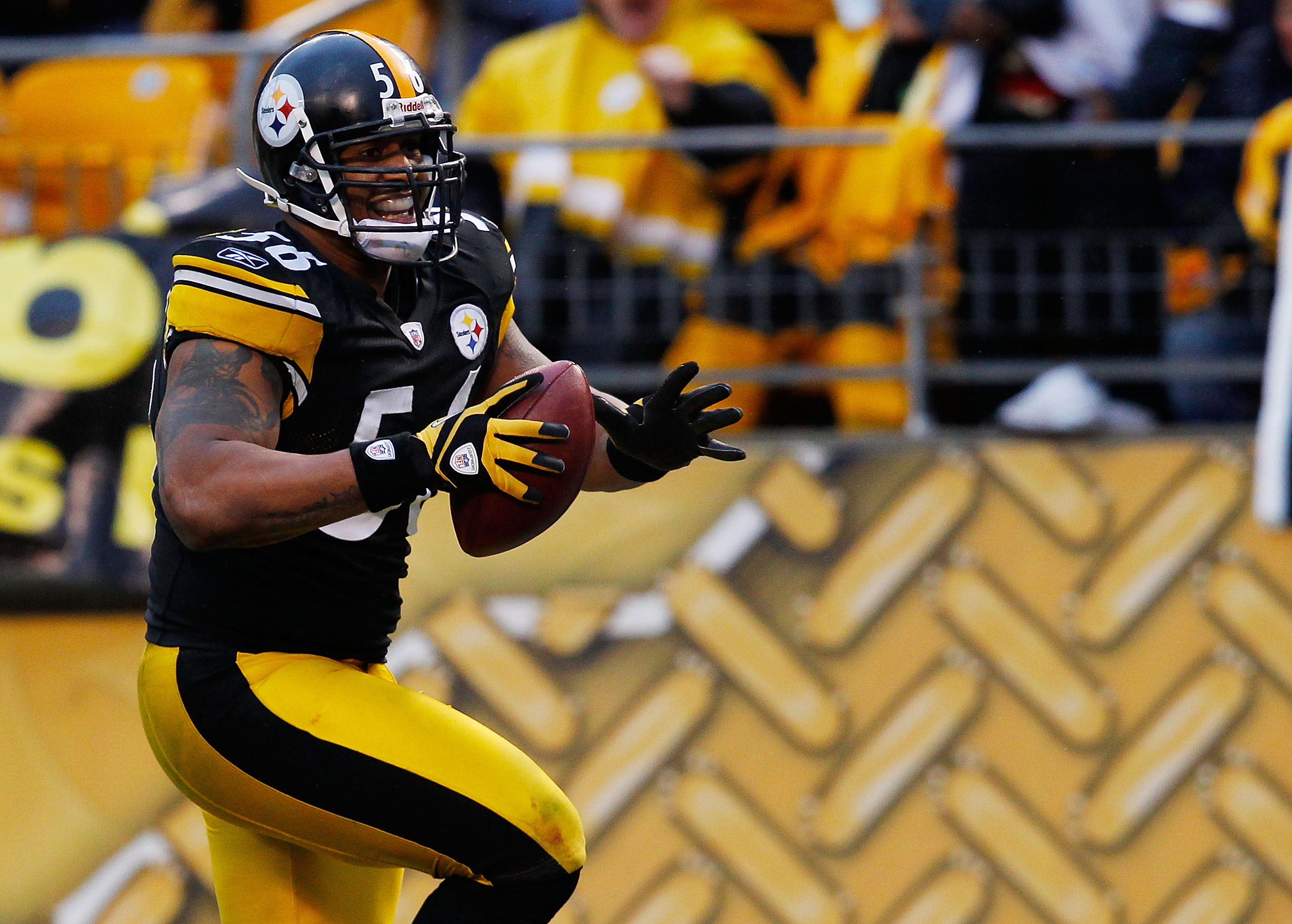 PITTSBURGH - DECEMBER 12:  LaMarr Woodley #56 of the Pittsburgh Steelers returns an interception for a touchdown against the Cincinnati Bengals during the game on December 12, 2010 at Heinz Field in Pittsburgh, Pennsylvania.  (Photo by Jared Wickerham/Get
