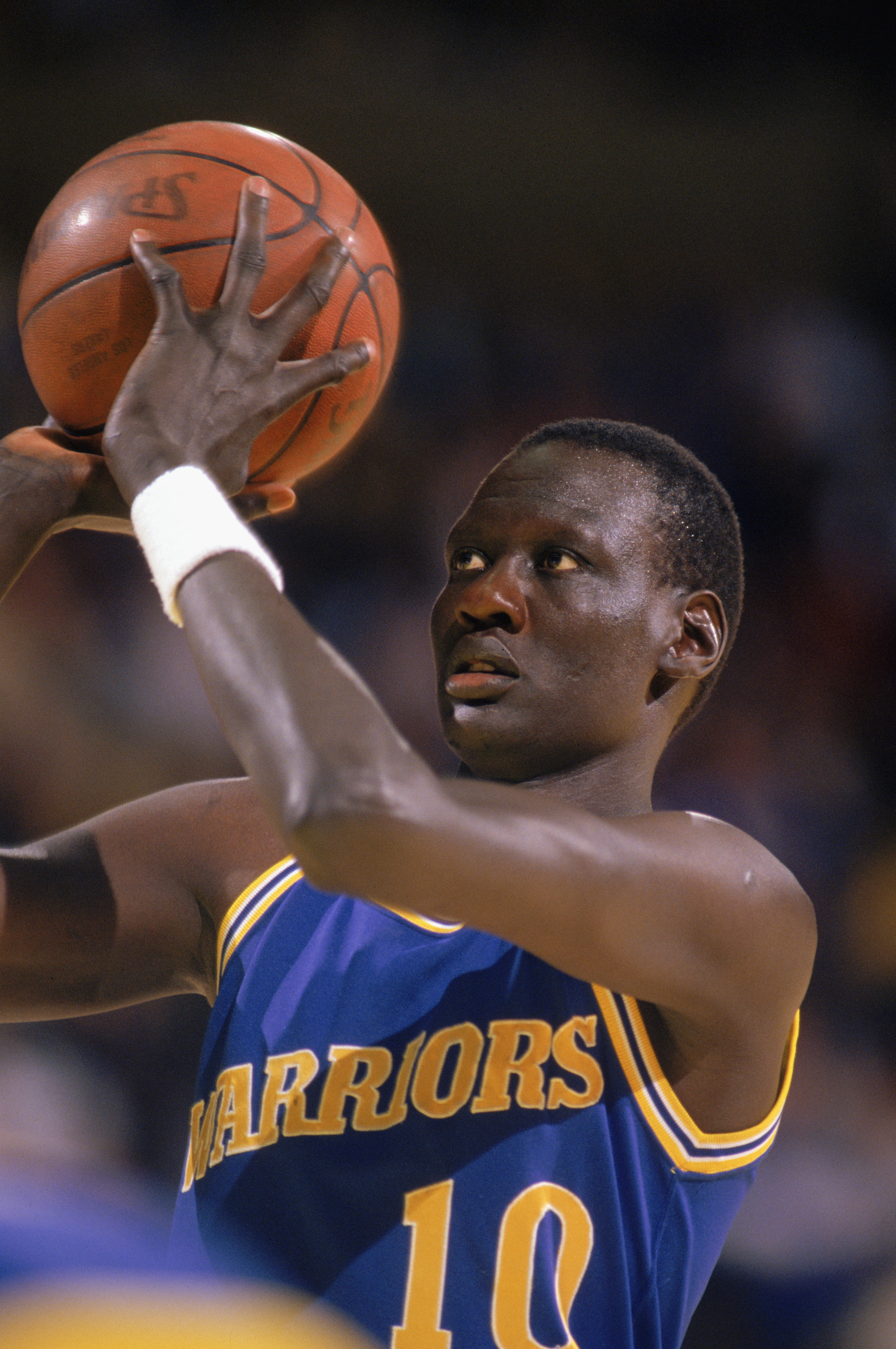 1988:  Manute Bol #10 of the Golden State Warriors looks to shoot during an NBA game in the 1988-89 season. NOTE TO USER: User expressly acknowledges and agrees that, by downloading and/or using this Photograph, User is consenting to the terms and conditi