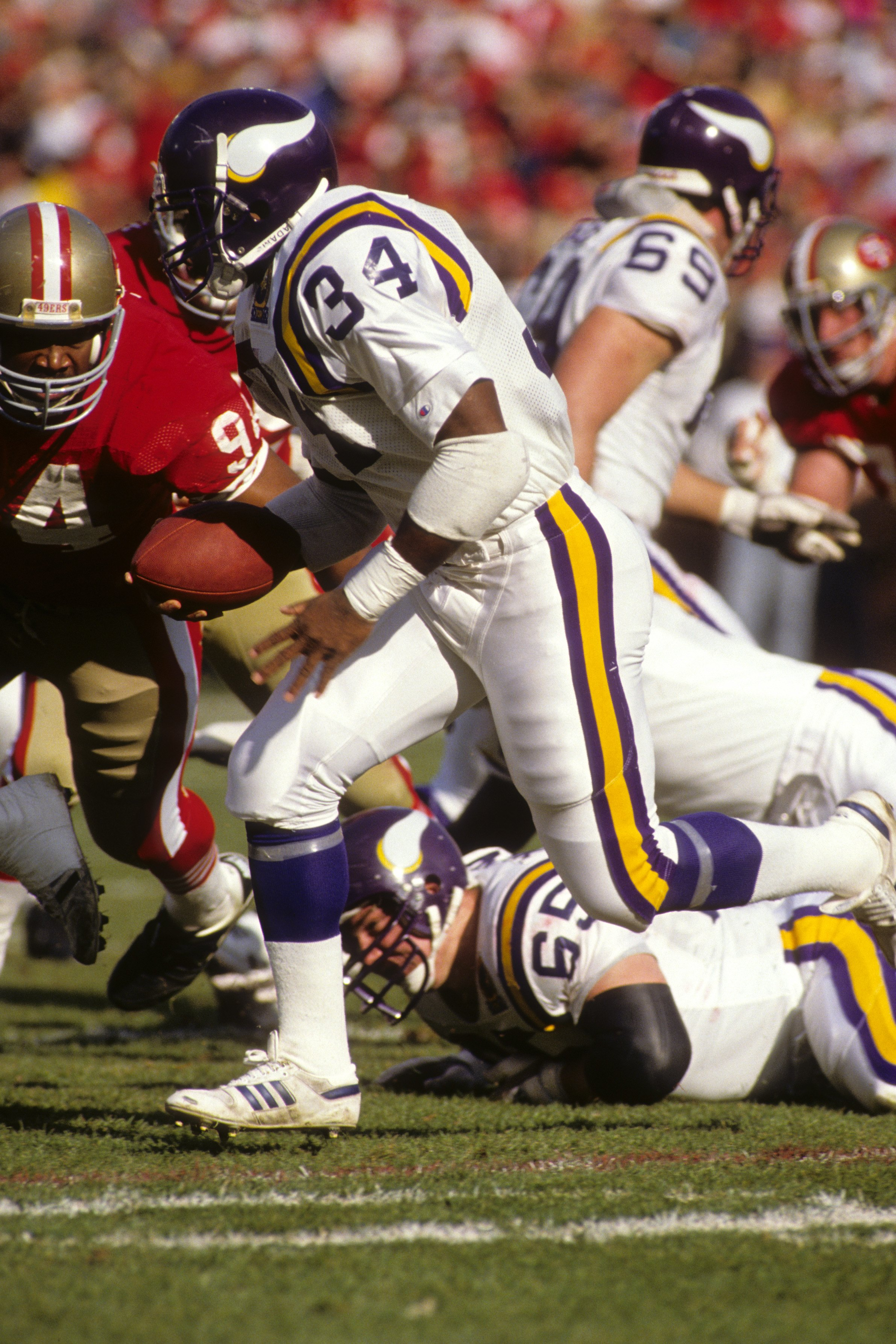 SAN FRANCISCO - JANUARY 6:  Running back Herschel Walker #34 of the Minnesota Vikings rushes for yards during the 1989 NFC Divisional Playoff game against the San Francisco 49ers at Candlestick Park on January 6, 1990 in San Francisco, California.  The 49