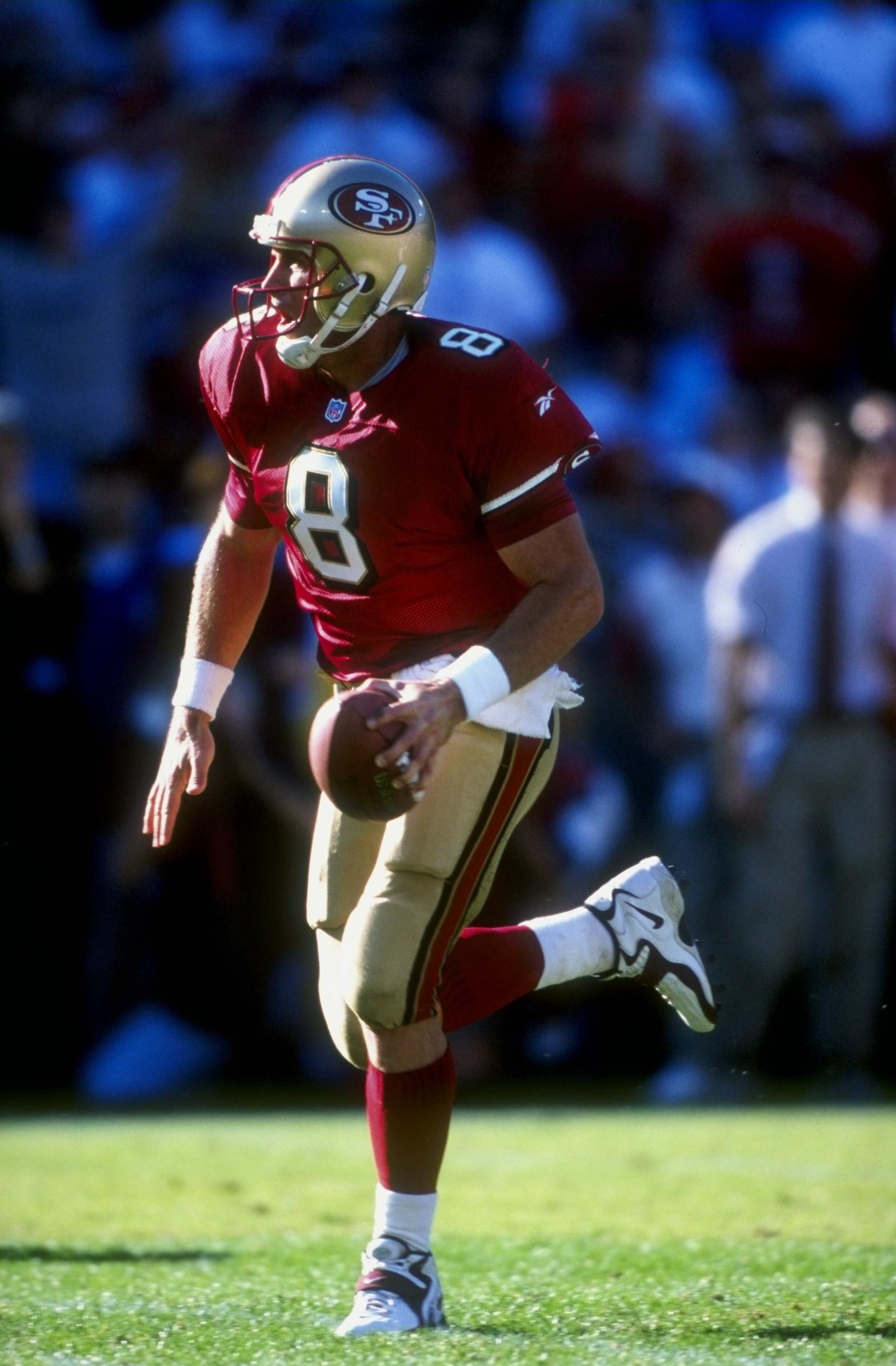 18 Oct 1998: Quarterback Steve Young #8 of the San Francisco 49ers runs as he looks to throw during the game against the Indianapolis Colts at 3Com Park in San Francisco, California. The 49ers defeated the Colts 34-31.