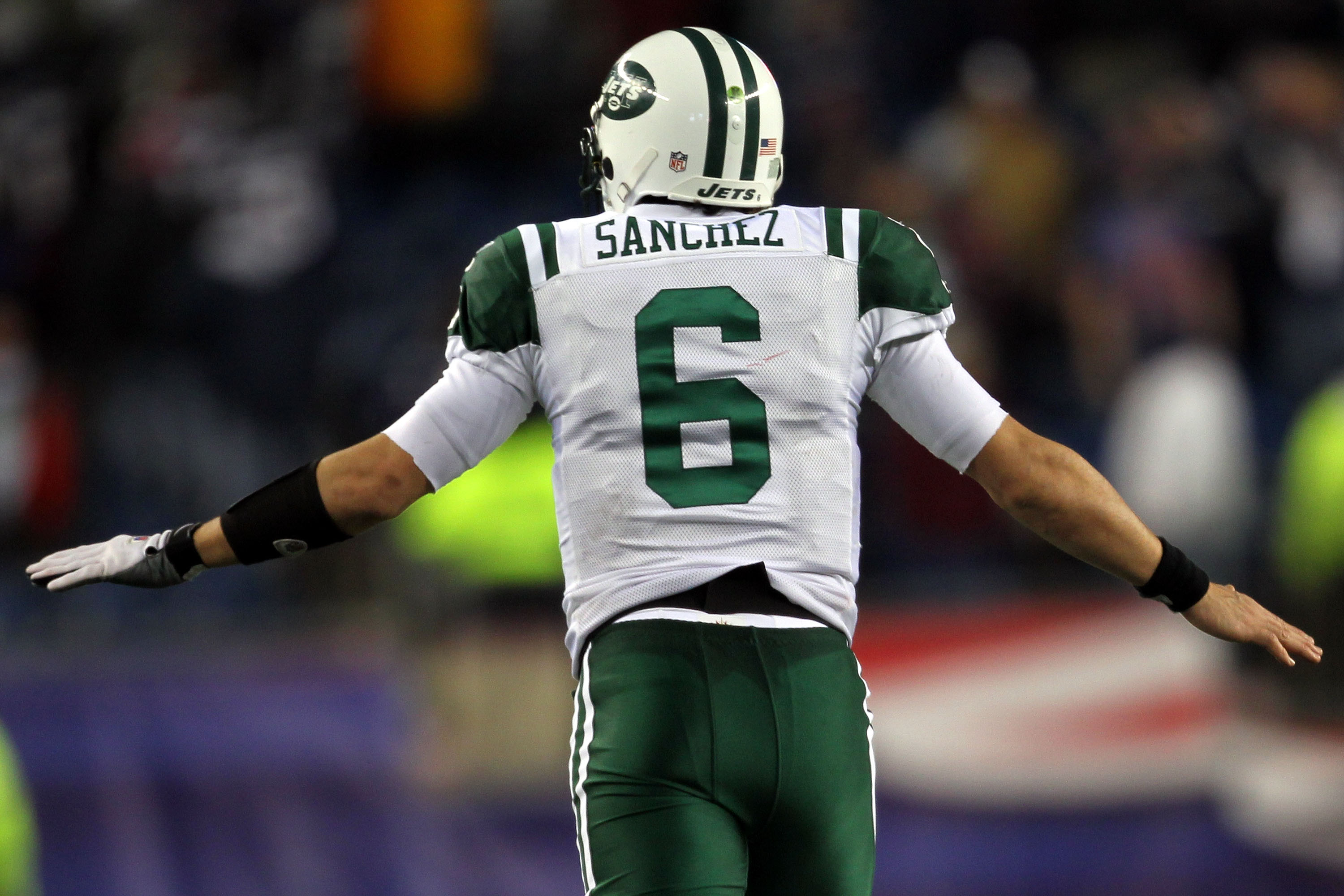 FOXBORO, MA - JANUARY 16:  Mark Sanchez #6 of the New York Jets celebrates after a touchdown late in the fourth quarter against the New England Patriots during their 2011 AFC divisional playoff game at Gillette Stadium on January 16, 2011 in Foxboro, Mass