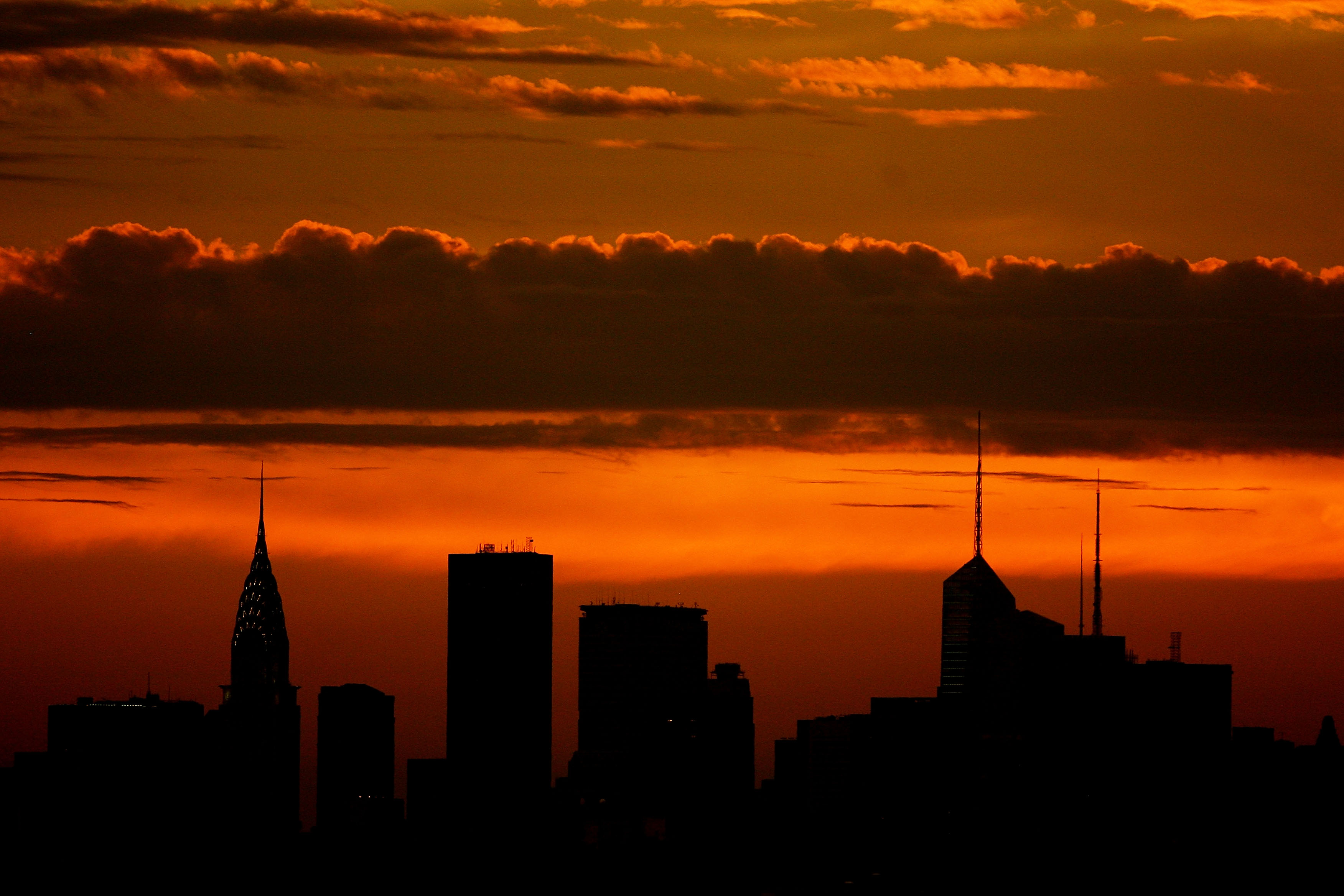 NEW YORK - SEPTEMBER 03:  The sun sets over the New York skyline during day five of the 2010 U.S. Open at the USTA Billie Jean King National Tennis Center on September 3, 2010 in the Flushing neighborhood of the Queens borough of New York City.  (Photo by