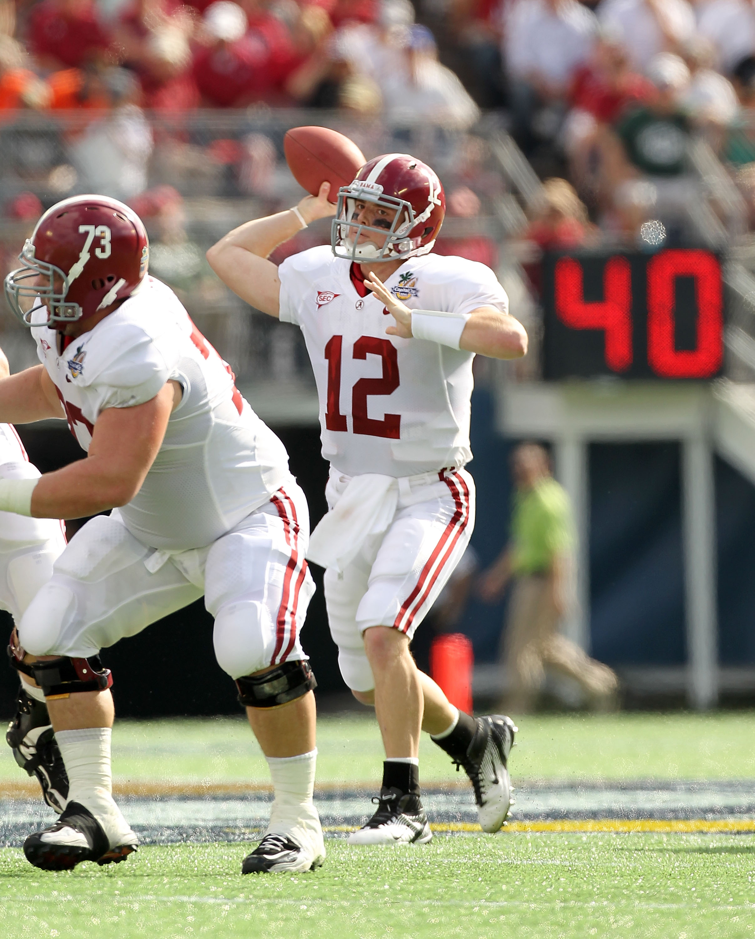 ORLANDO, FL - JANUARY 01:  Greg McElroy #12 of the Alabama Crimson Tide passes the ball during the Capitol One Bowl against the Michigan State Spartans at the Florida Citrus Bowl on January 1, 2011 in Orlando, Florida.  (Photo by Mike Ehrmann/Getty Images