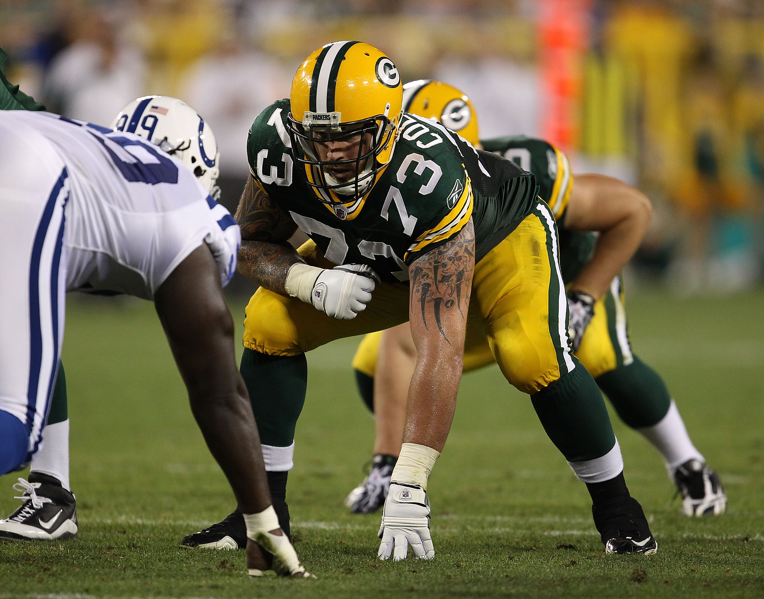 GREEN BAY, WI - AUGUST 26: Daryn Colledge #73 of the Green Bay Packers awaits the start of play against the Indianapolis Colts during a preseason game at Lambeau Field on August 26, 2010 in Green Bay, Wisconsin. The Packers defeated the Colts 59-24. (Phot