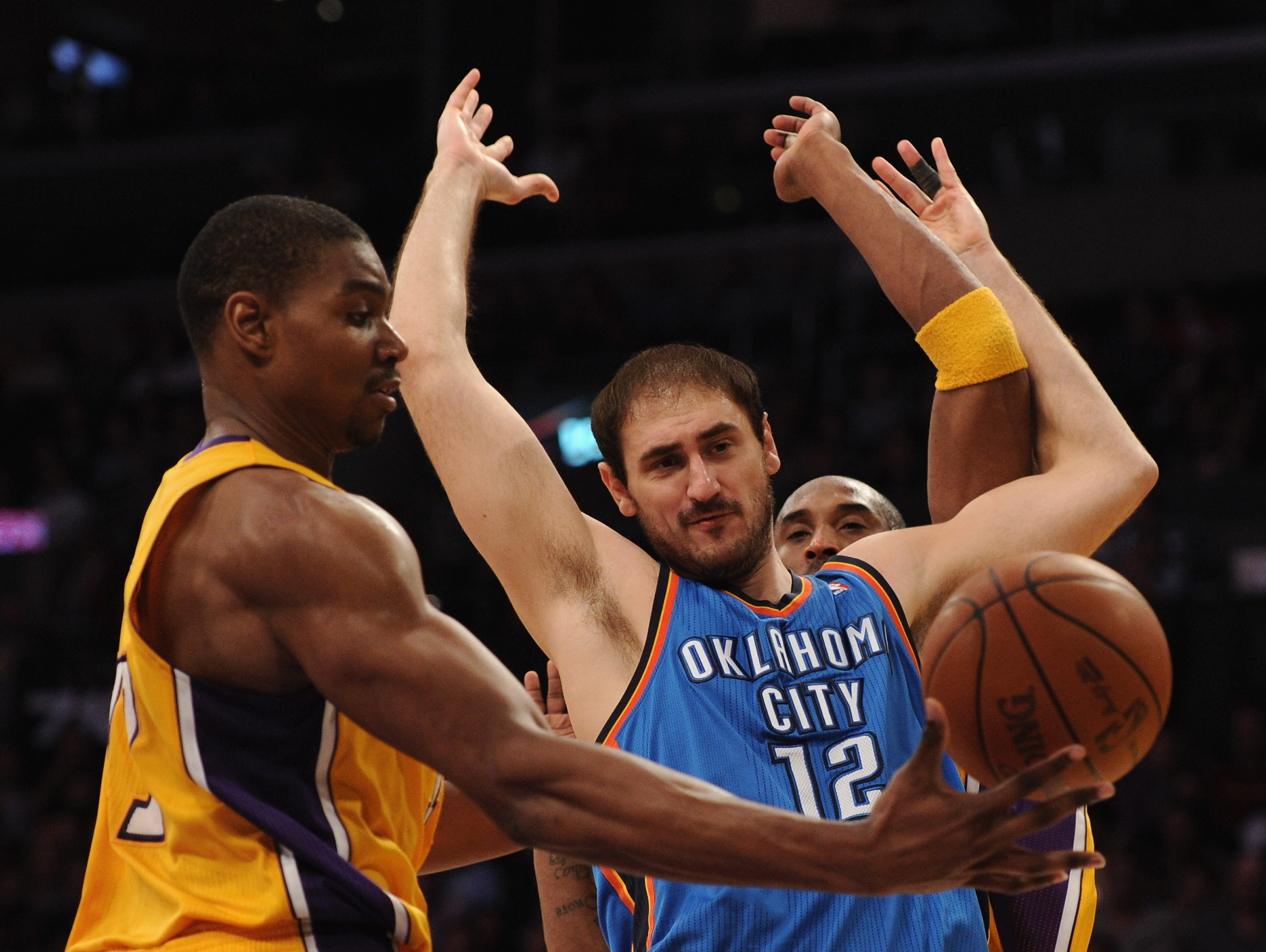 LOS ANGELES, CA - JANUARY 17:  Nenad Krstic #12 of the Oklahoma City Thunder is fouled by Kobe Bryant #24 Los Angeles Lakers as Andrew Bynum #17 takes the ball during a 101-94 Laker win at the Staples Center on January 17, 2011 in Los Angeles, California.
