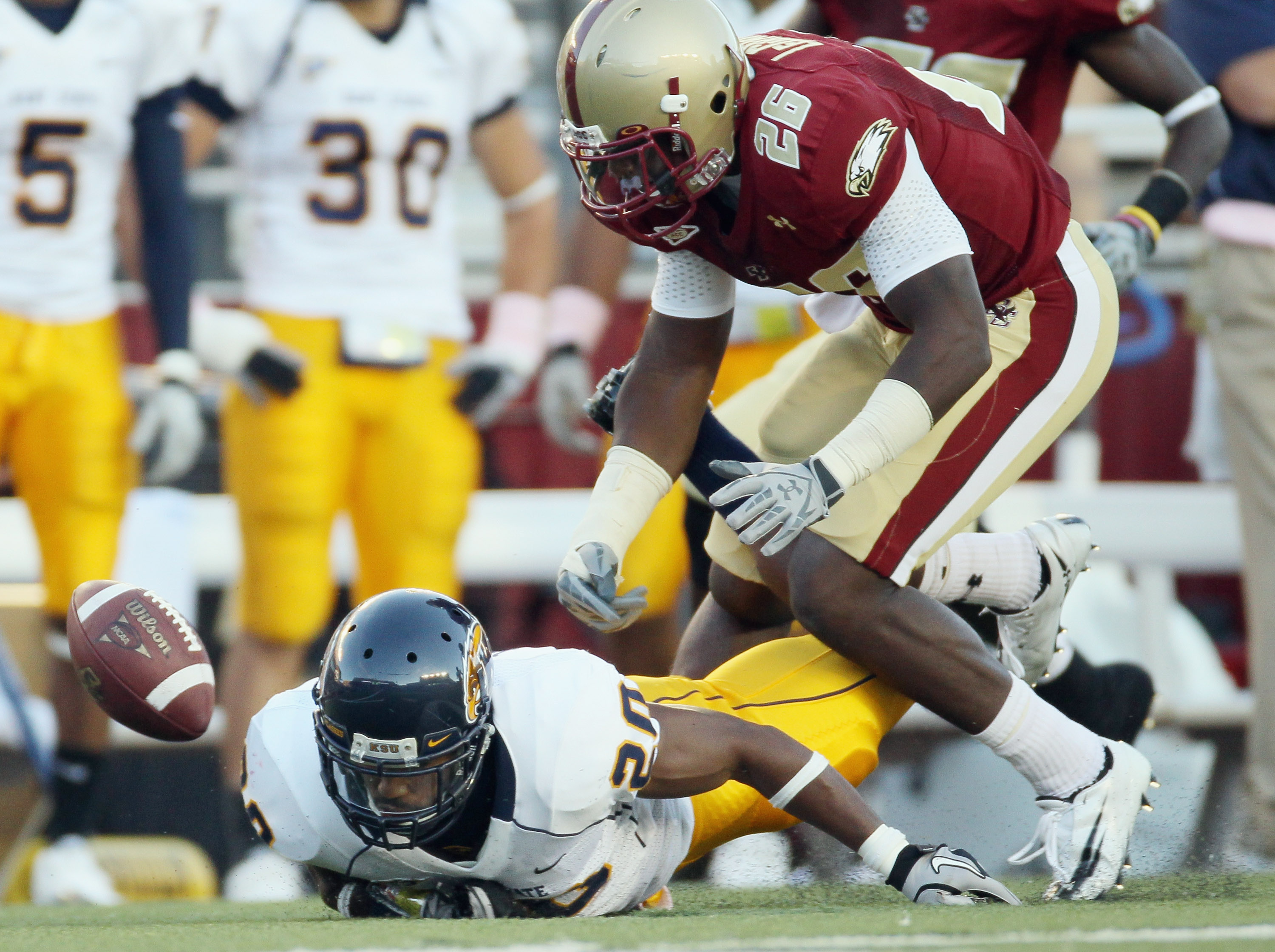 CHESTNUT HILL, MA - SEPTEMBER 11: Dominick LeGrande #26 of the Boston College Eagles and Will Johnson #20 of the Kent State Golden Flashes chase after the fumble on September 11, 2010 at Alumni Stadium in Chestnut Hill, Massachusetts. Boston College defea