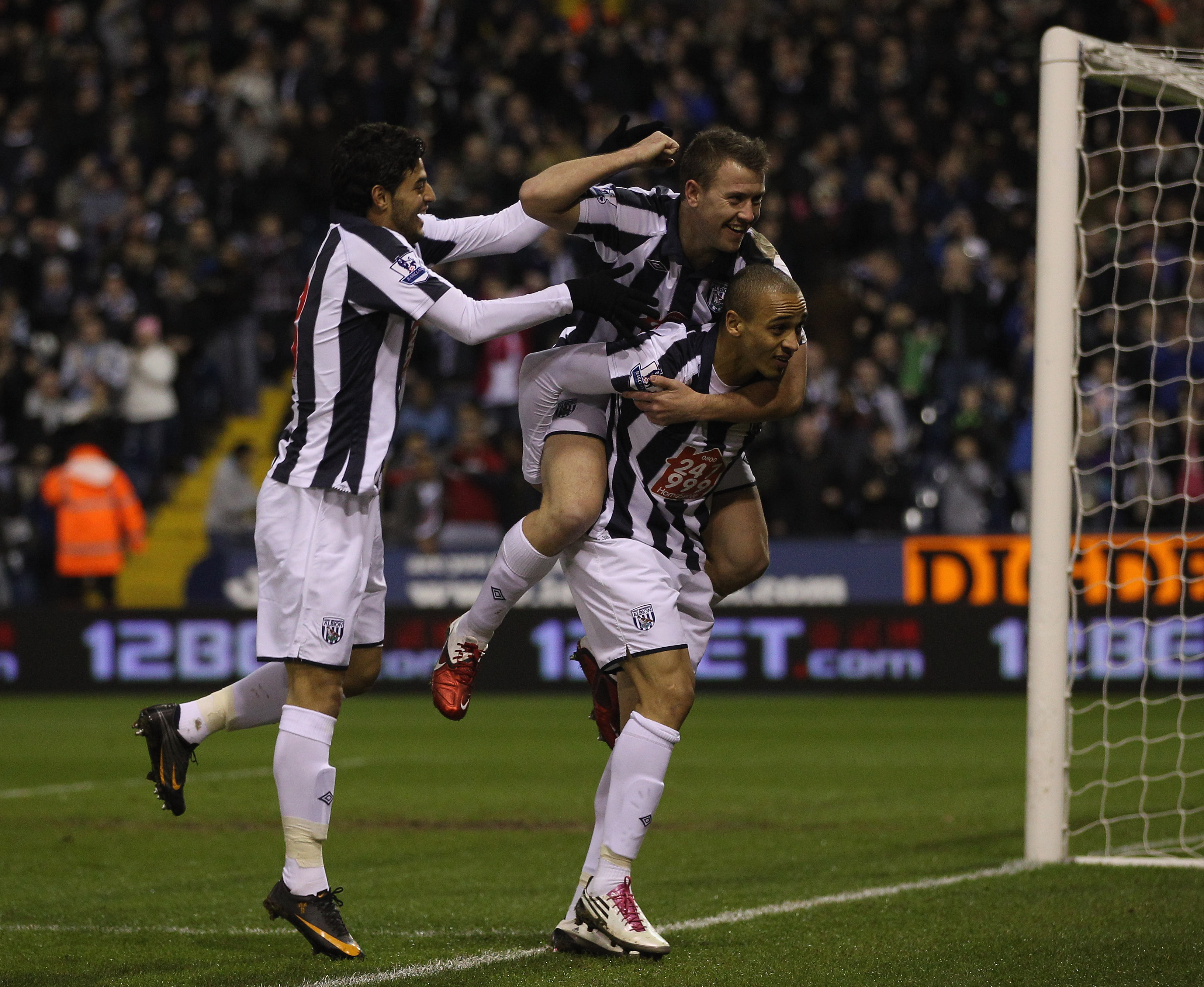 WEST BROMWICH, ENGLAND - FEBRUARY 01:  Peter Odemwingie of West Brom celebrates scoring the first goal during the Barclays Premier League match between West Bromwich Albion and Wigan Athletic at The Hawthorns on February 1, 2011 in West Bromwich, England.