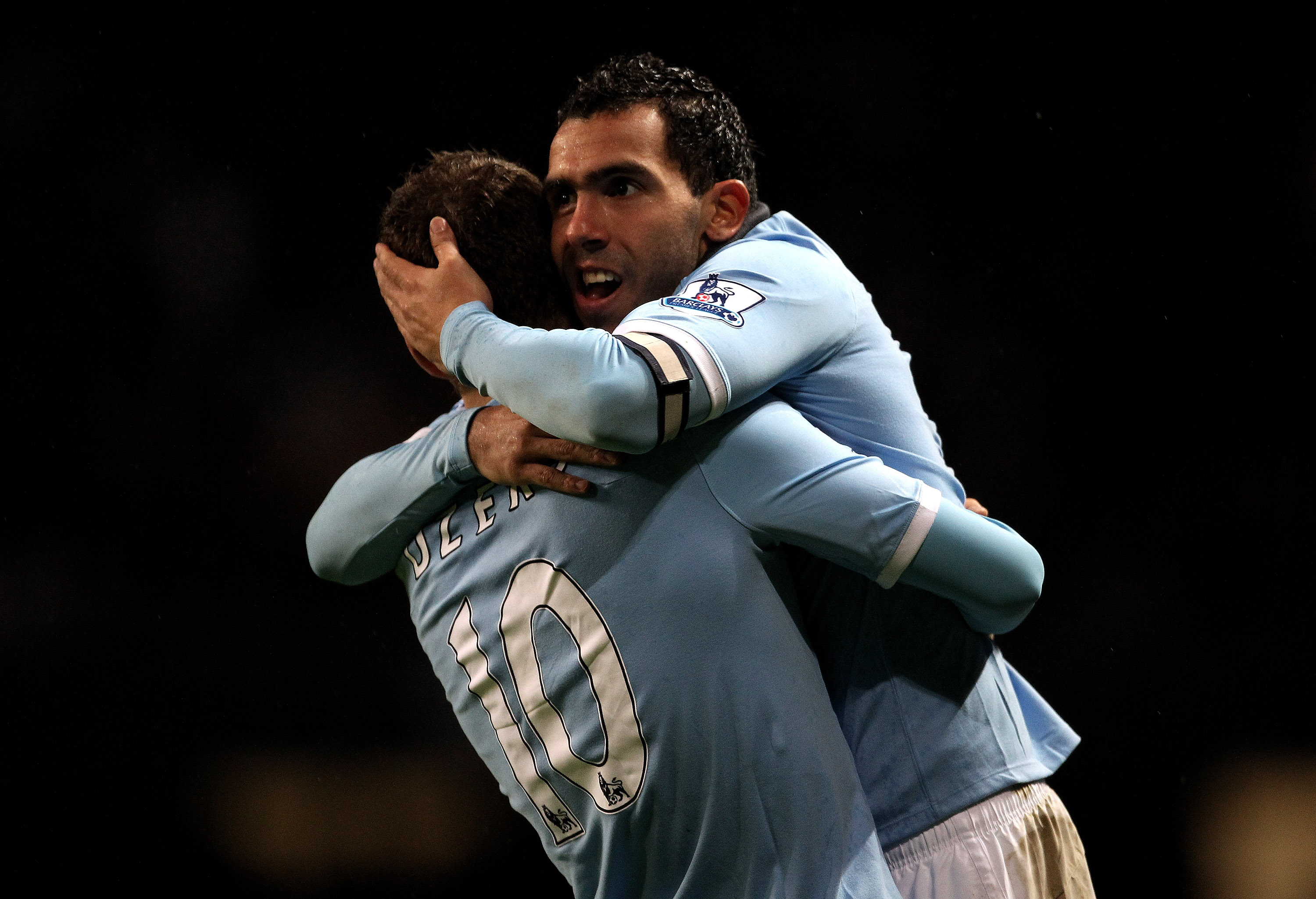 MANCHESTER, ENGLAND - JANUARY 15:  Carlos Tevez of Manchester City celebrates scoring his team's fourth goal with team mate Edin Dzeko during the Barclays Premier League match between Manchester City and Wolverhampton Wanderers at the City of Manchester S