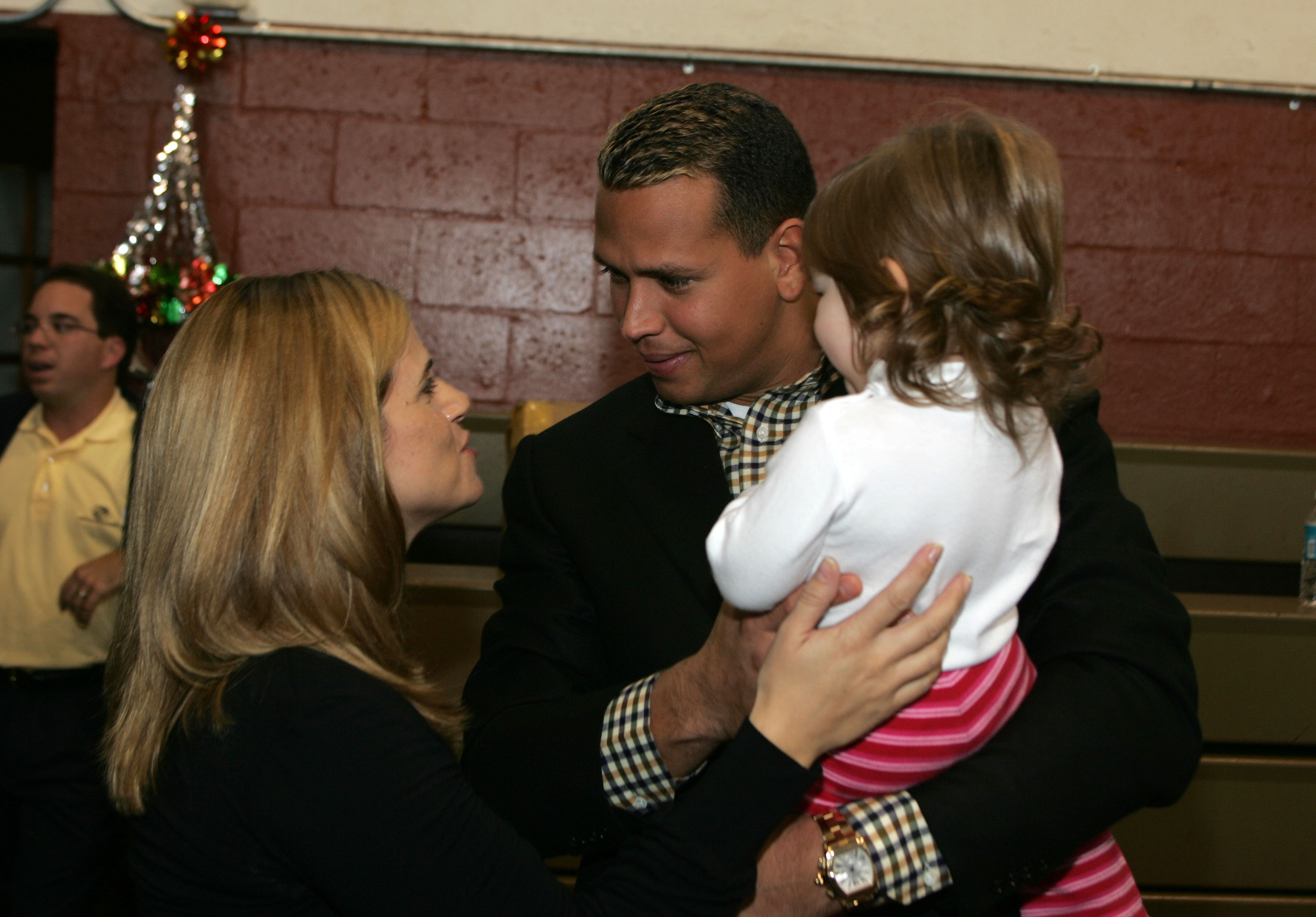 MIAMI - DECEMBER 15:  Baseball player Alex Rodriguez and wife Cynthia host a Christmas party at The Boys and Girls Clubs Of Miami on December 15, 2004 in Miami.  (Photo by Alexander Tamargo/Getty Images)