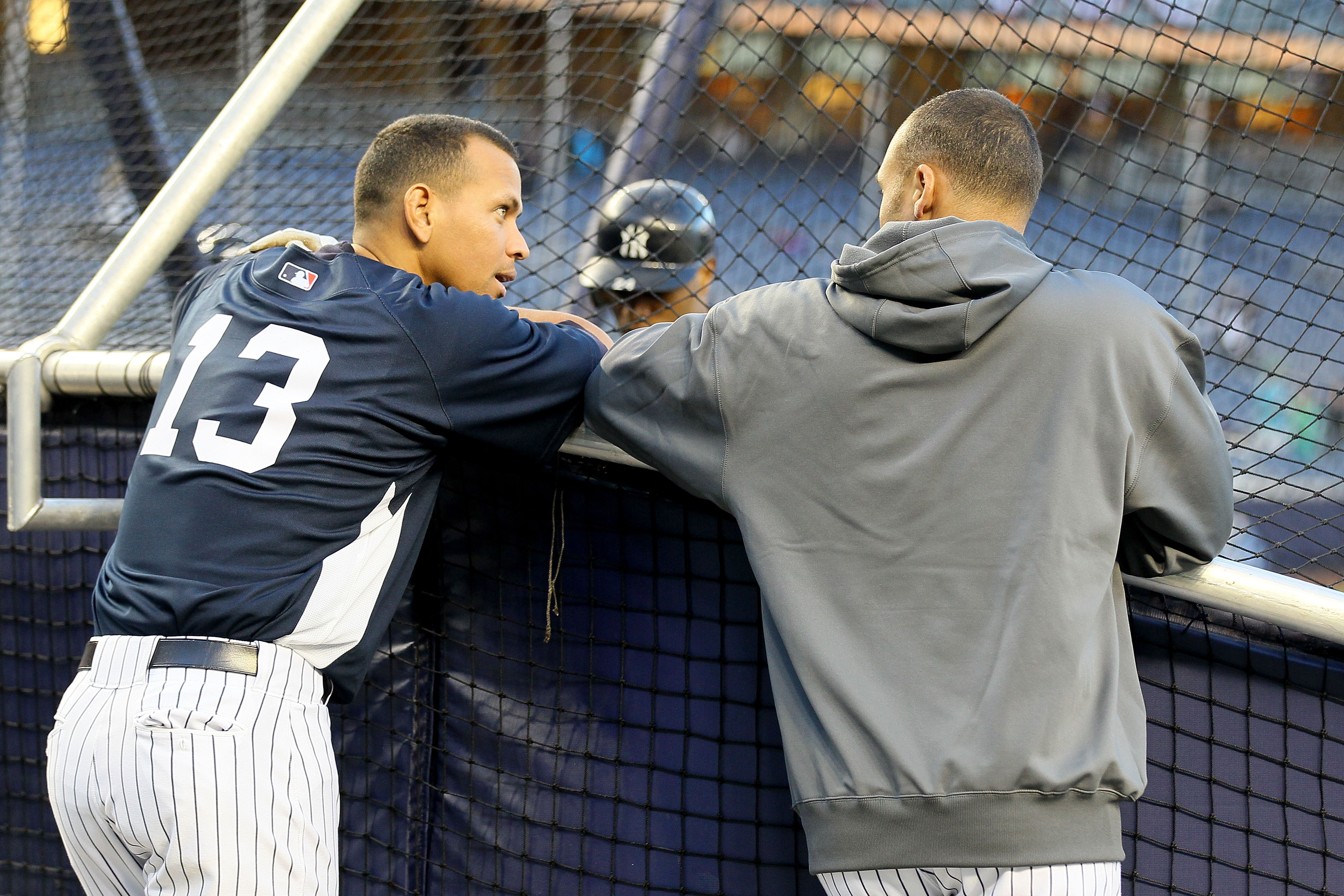 NEW YORK - OCTOBER 09:  (L-R) Alex Rodriguez #13 and Derek Jeter #2 of the New York Yankees talk behind the batting cage against the Minnesota Twins during Game Three of the ALDS part of the 2010 MLB Playoffs at Yankee Stadium on October 9, 2010 in the Br