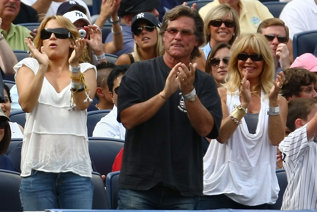 NEW YORK - AUGUST 08:  Kate Hudson, Kurt Russell and Goldie Hawn clap as Alex Rodriguez of the New York Yankees steps up to bat against the Boston Red Sox during their game on August 8, 2009 at Yankee Stadium in the Bronx borough of New York City.  (Photo
